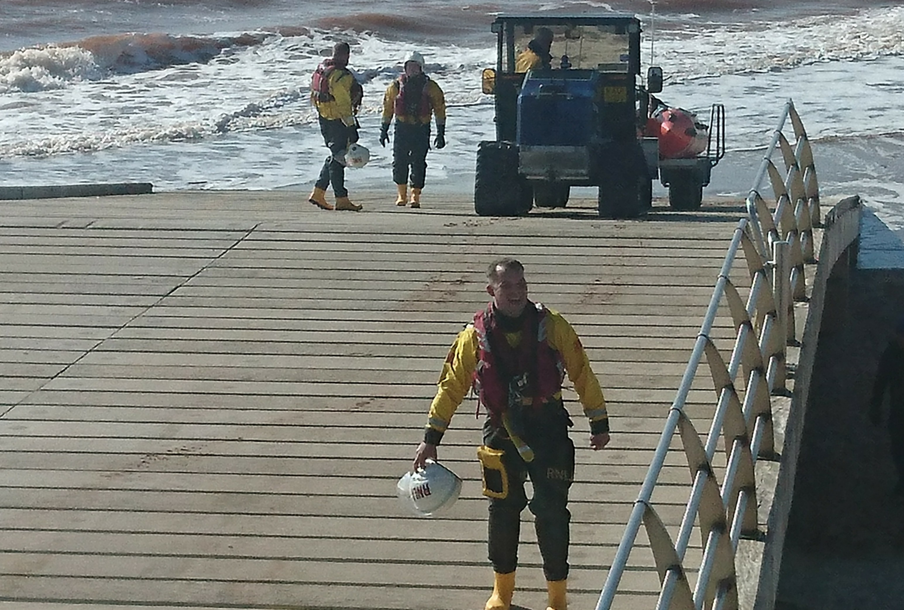 Crew volunteers returning after kite-surfer rescue with inshore lifeboat George Bearman II