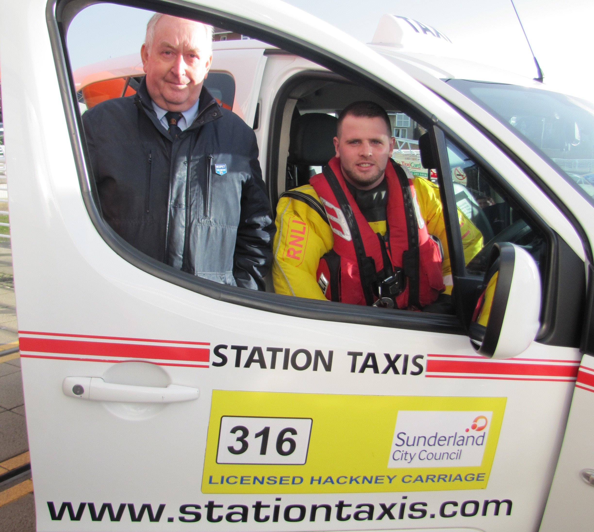 Station Taxis Managing Director Trevor Hines with Sunderland RNLI volunteer Jonny Lindsley