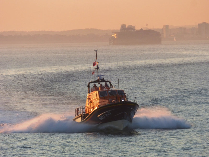 RNLB Alfred Albert Williams at sunset with Portsmouth behind her