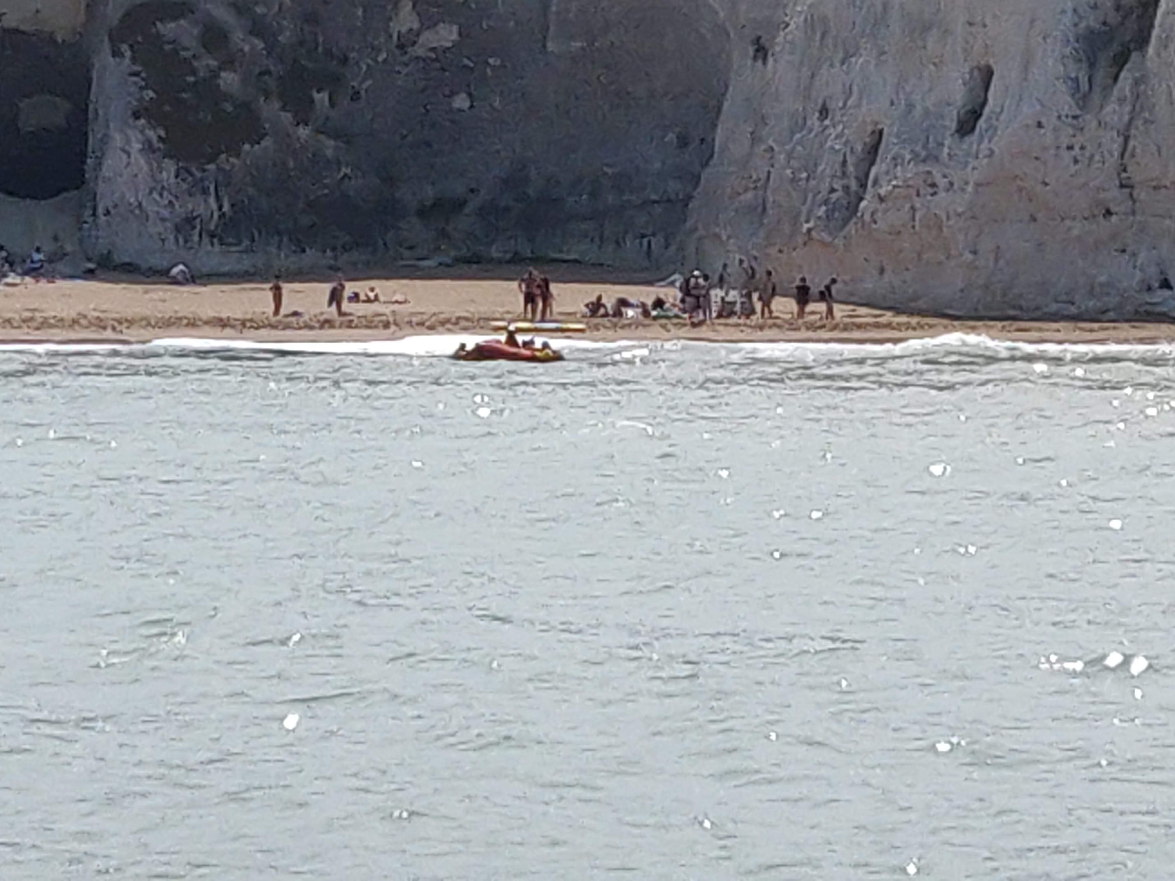 Beach-goers cut off by the tide