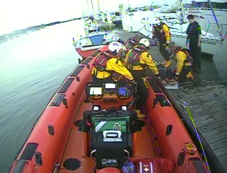 Calshot RNLI transferring casualty to Atlantic 85 Lifeboat