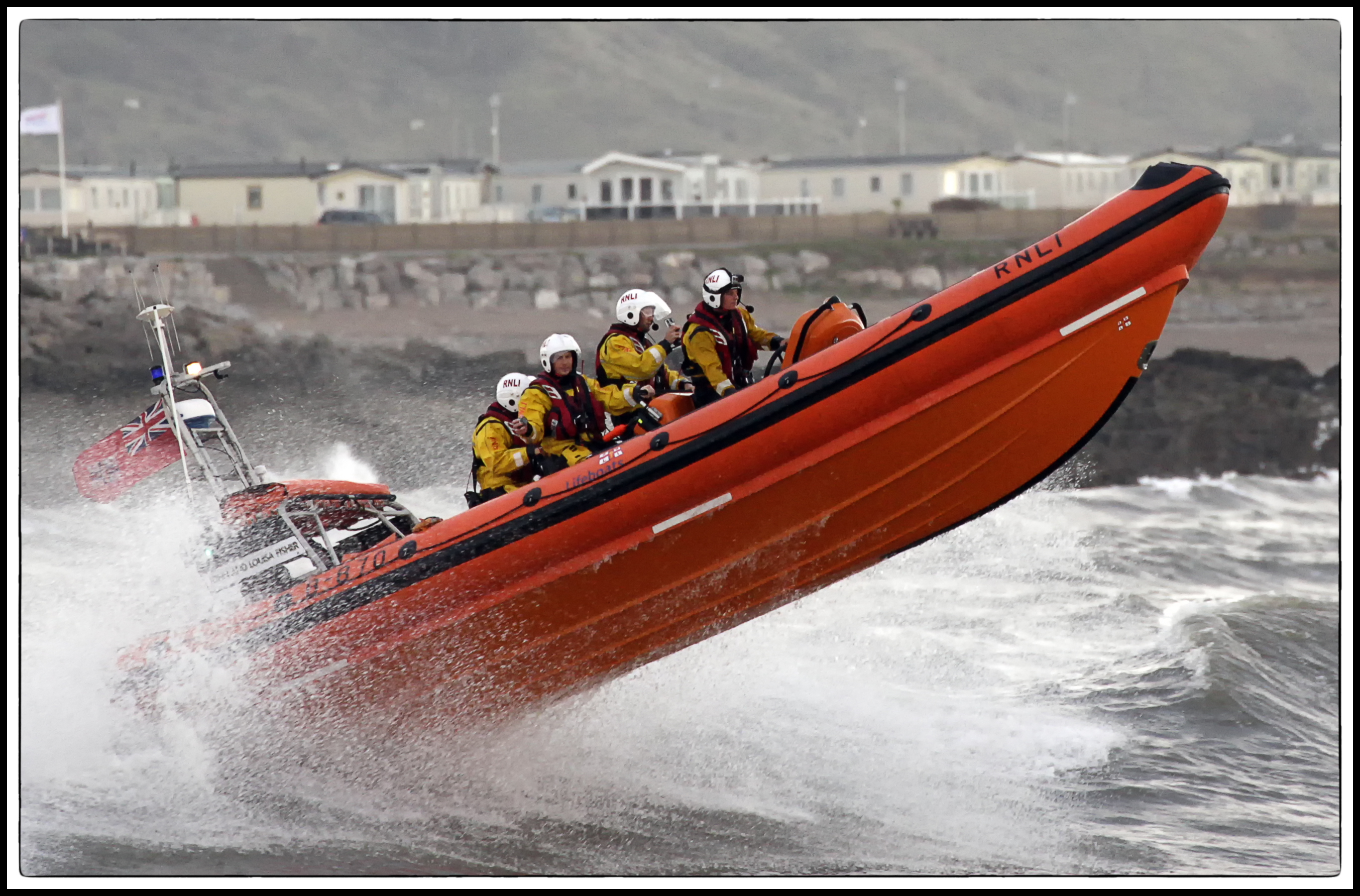 Lifeboat heading out through the surf at Sandy Bay, Porthcawl
