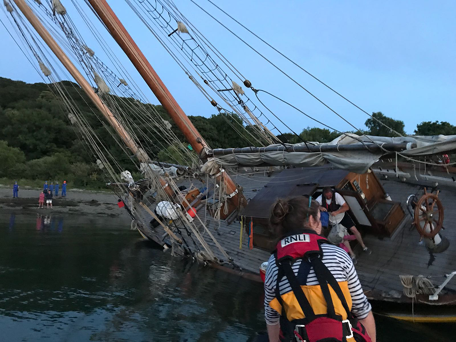 The schooner aground at Turnaware Point after suffering a mechanical failure
