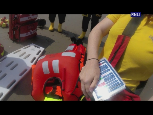 Rhyl RNLI Inshore Lifeboat carries out a casualty care exercise with Rhyl RNLI lifeguards.