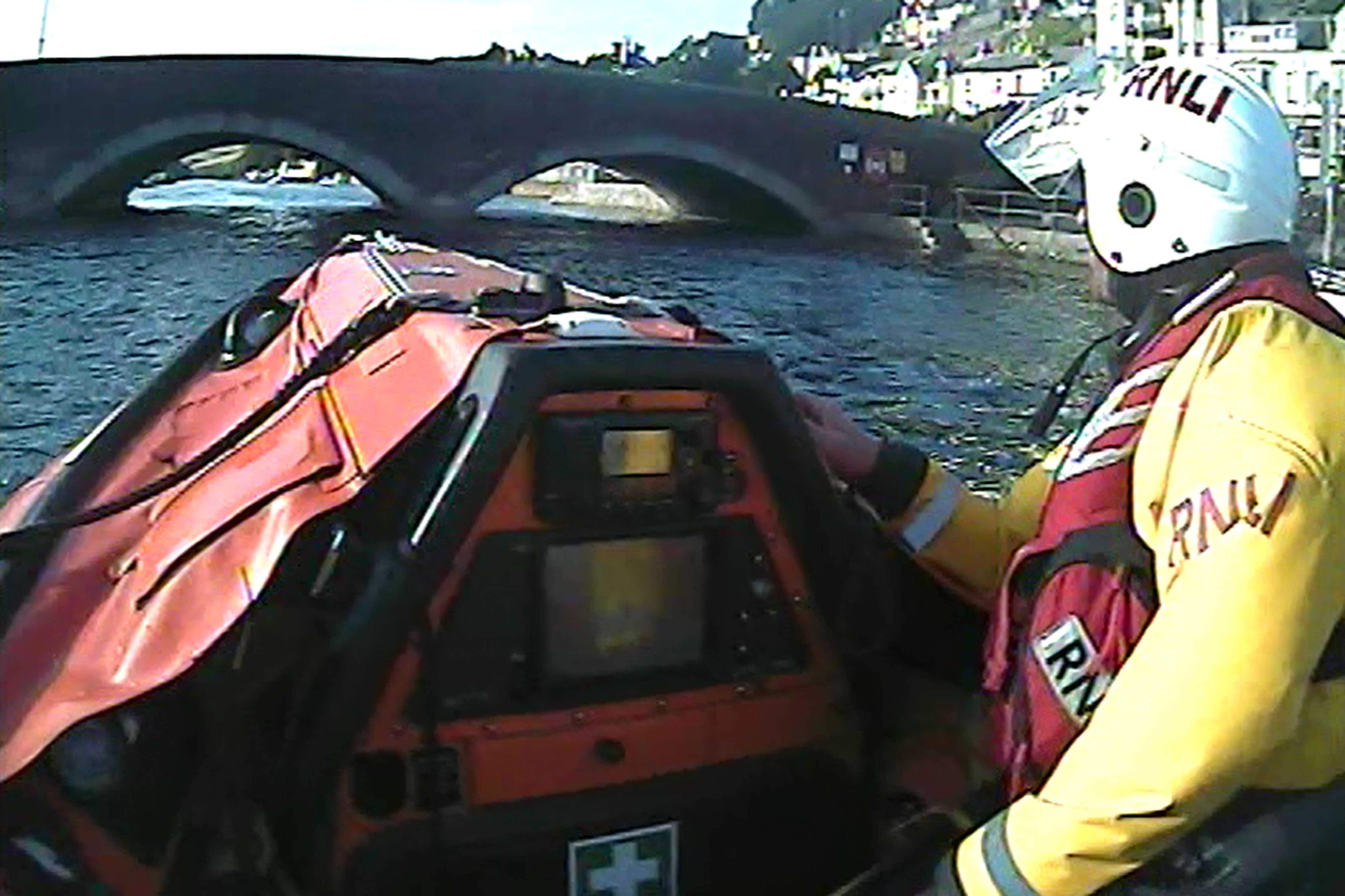 Looe RNLI's D Class inshore lifeboat Ollie Naismith heading up river towards the casualty