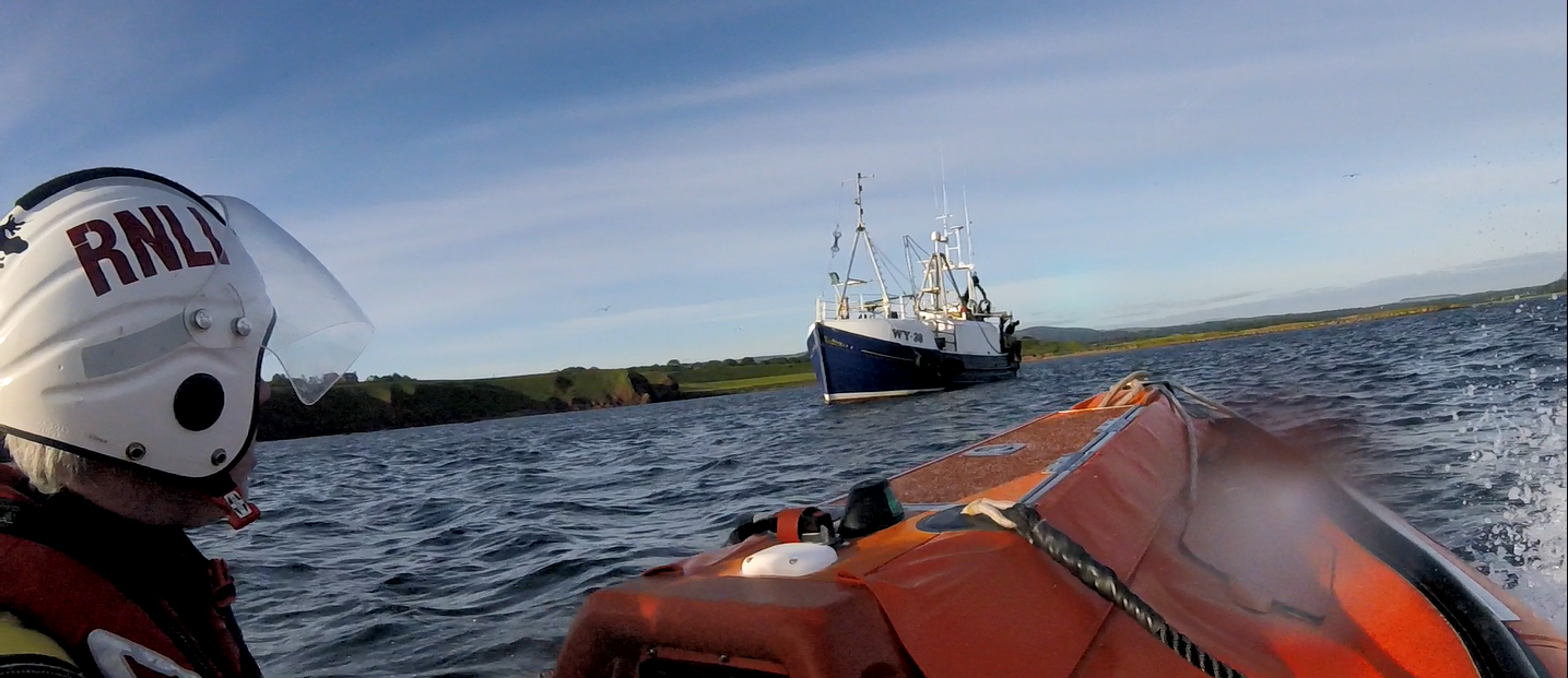 Dunbar ILB arriving on scene where fishing boat has run aground on rocks.