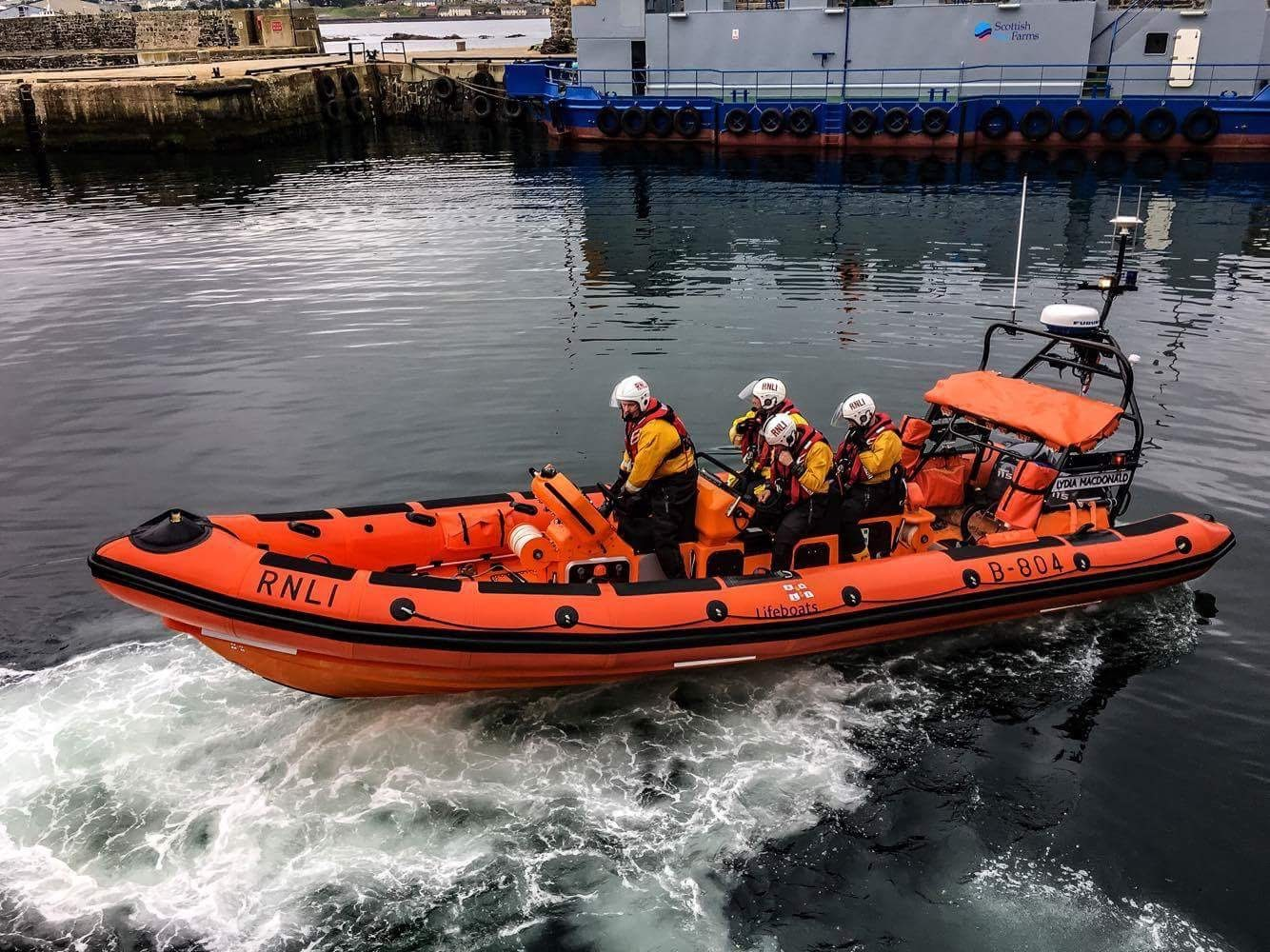 Orange lifeboat B 804 with four crew on board