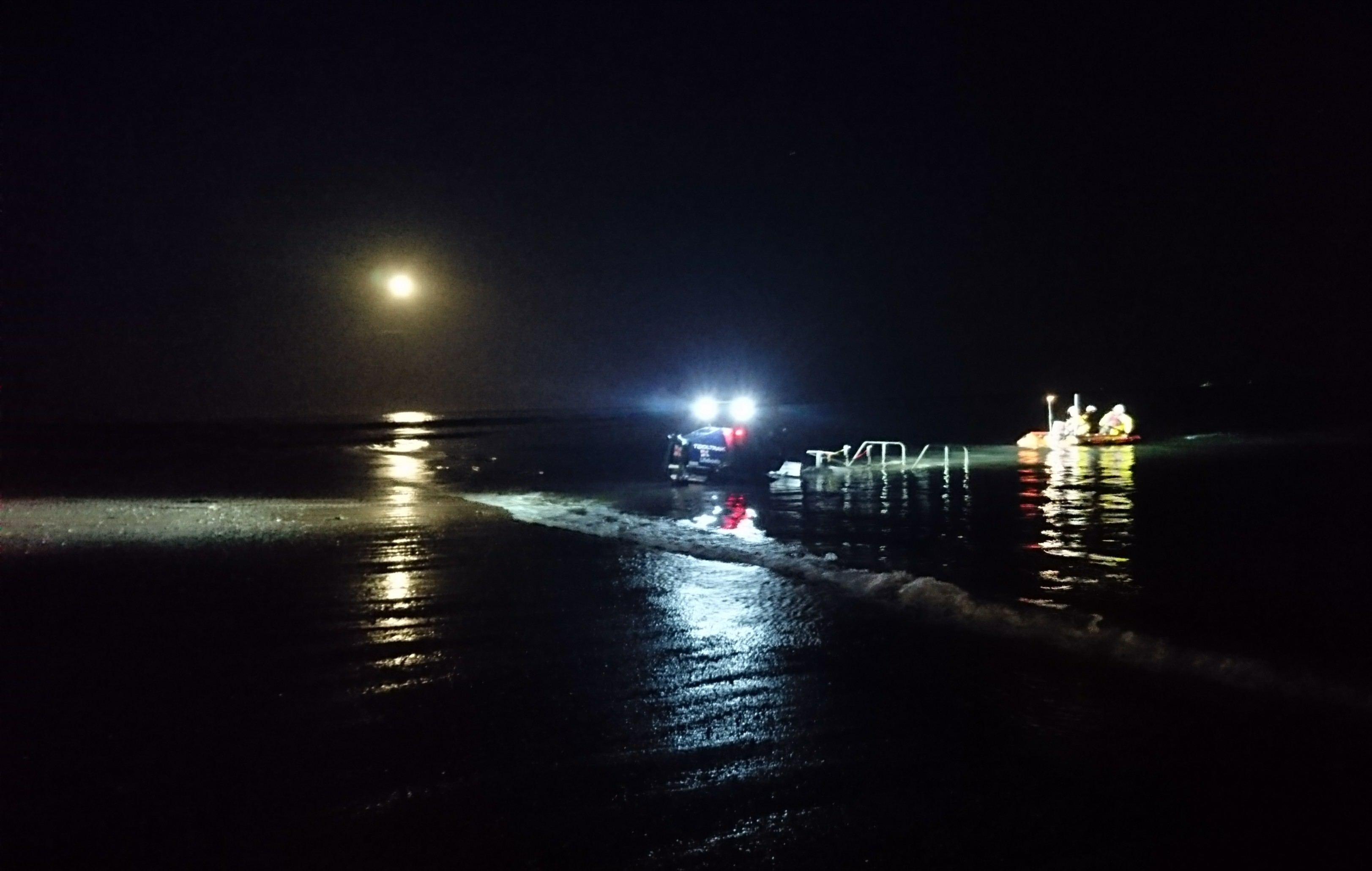 D class lifeboat George Bearman II recovers under a full moon