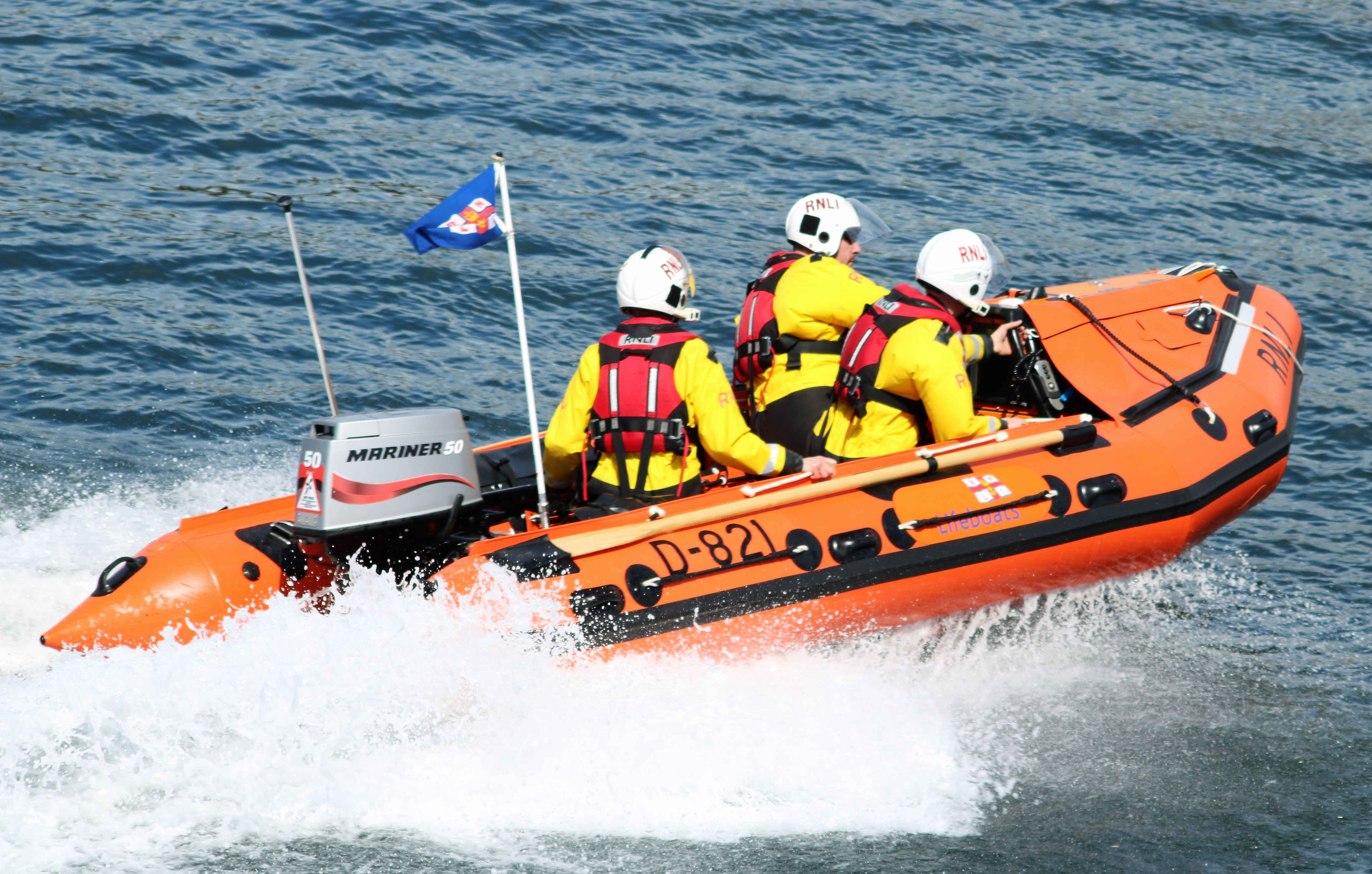 Troon D class inshore lifeboat 'Sheena' with three crew on board making