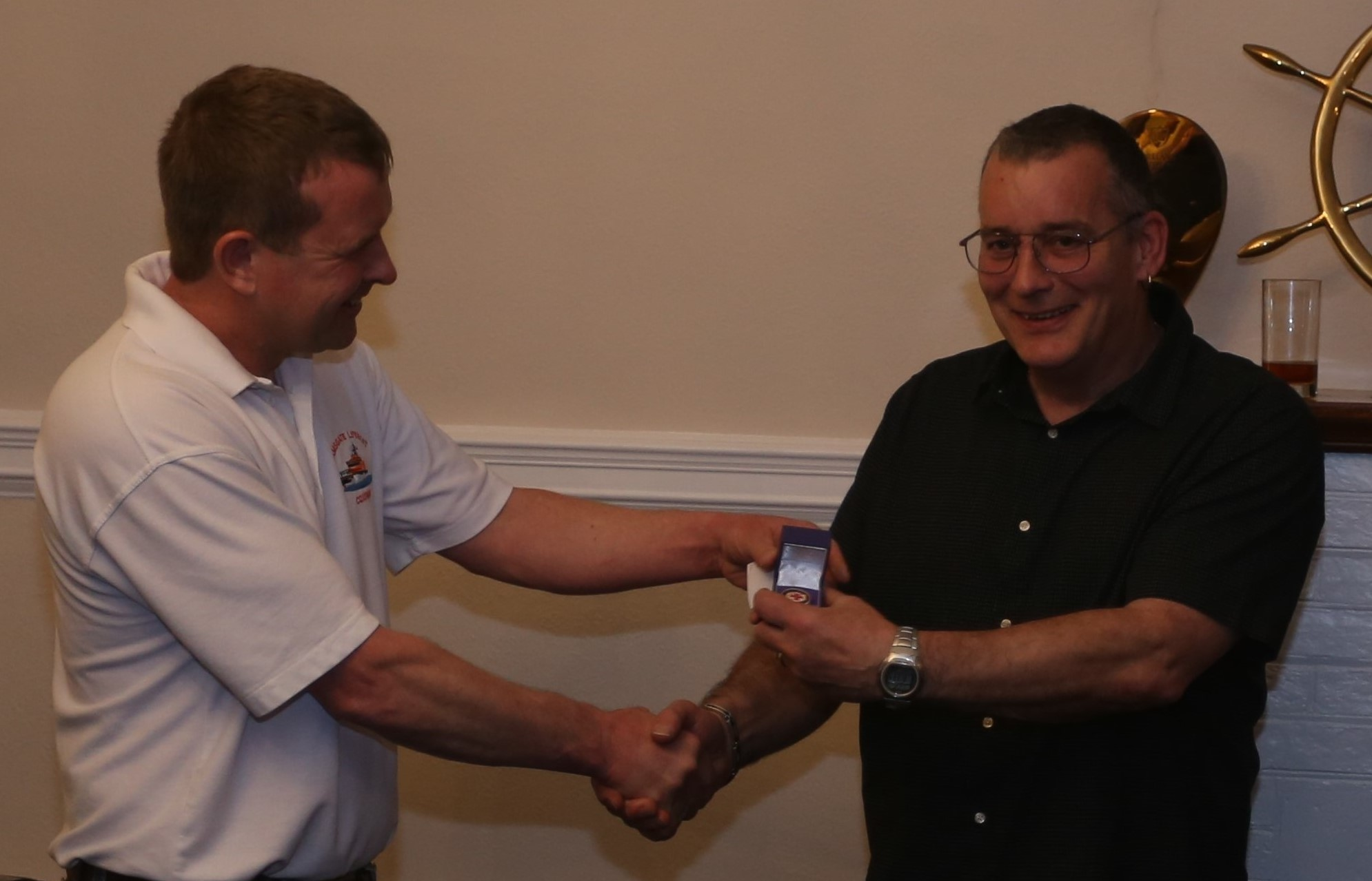 Coxswain Ian Cannon presenting Phil Mace with his 20 year medal