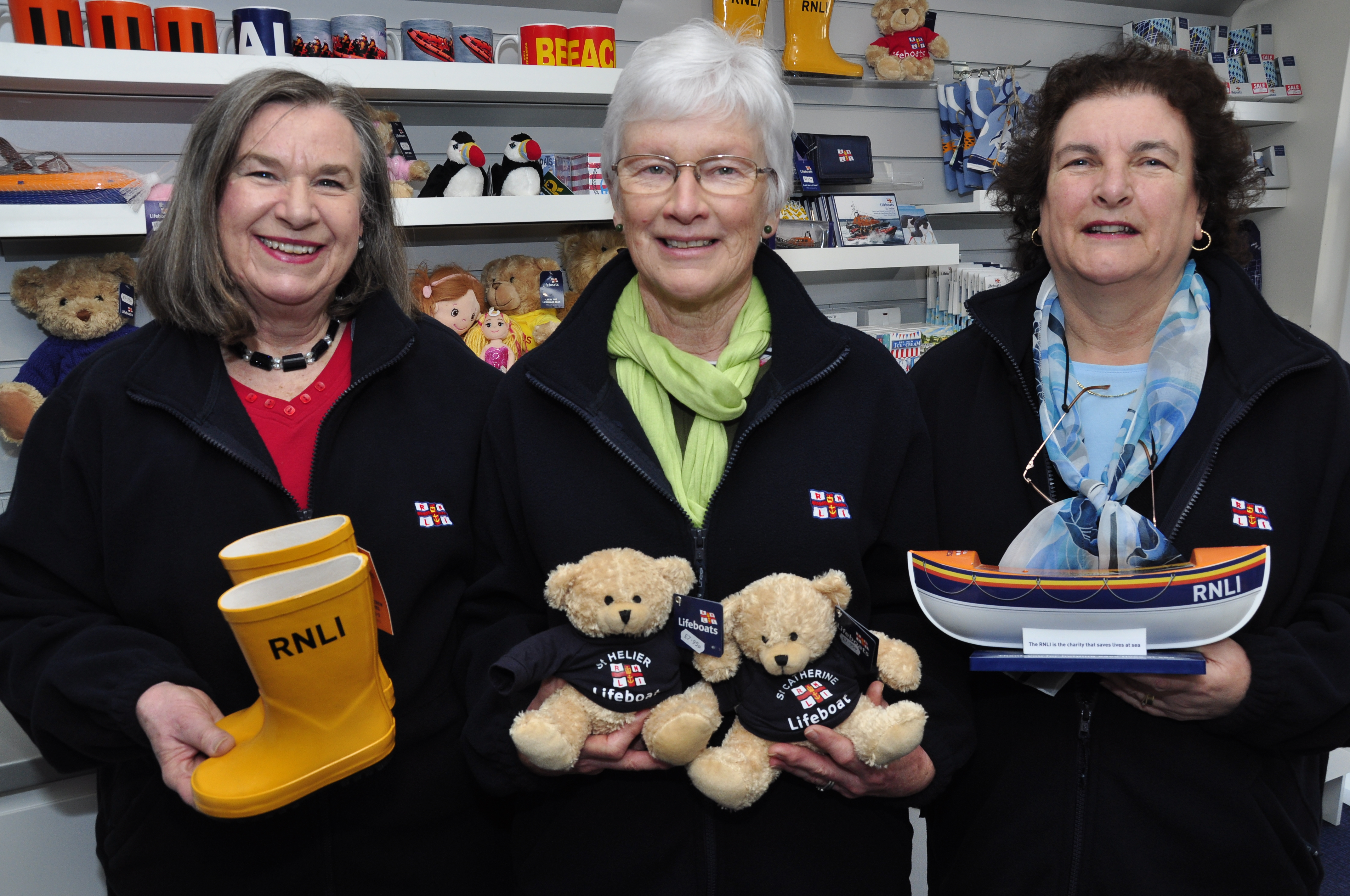 Volunteers from the Jersey Lifeboat Guild prepare for the opening. From left to right: Josephine Spary, Chairman of the Jersey Lifeboat Guild and shop volunteer, Mary Mimmack, shop manager and Michelene Vezier, deputy shop manager.