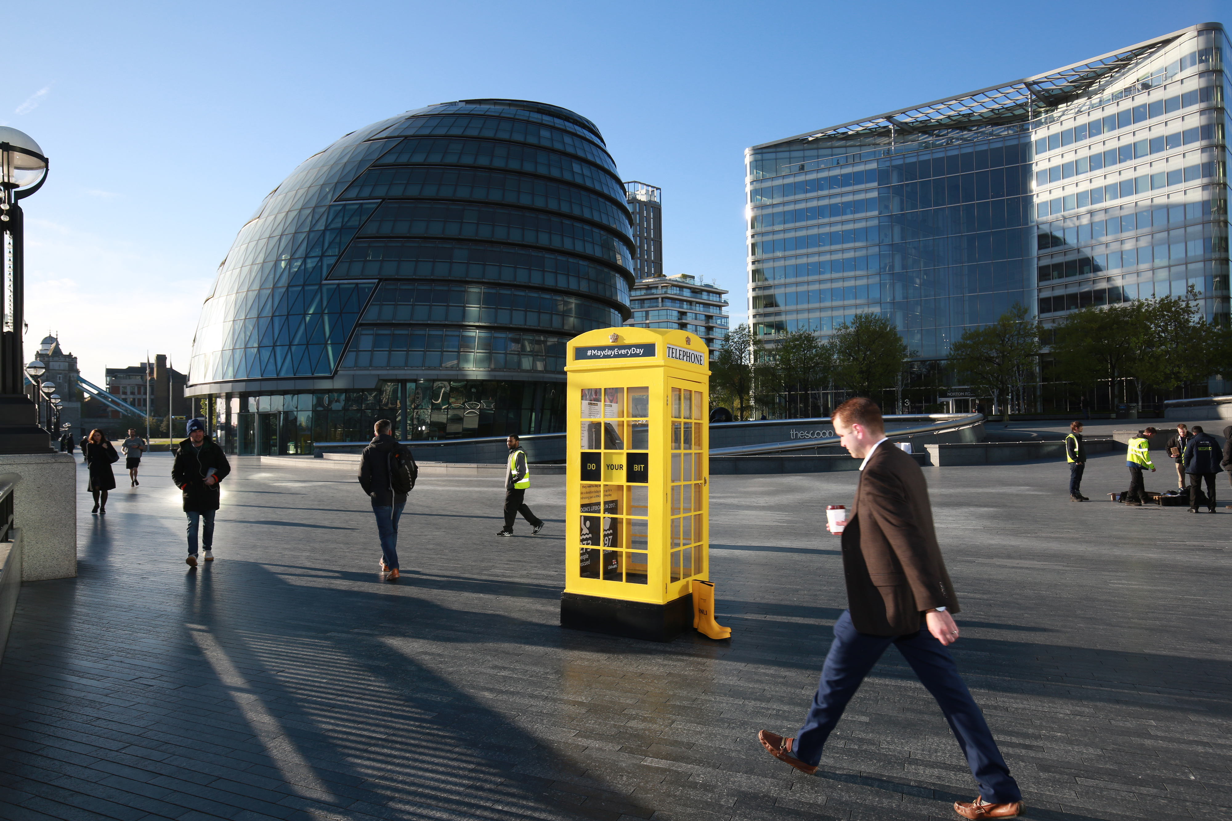 RNLI yellow phone box outside London's City Hall