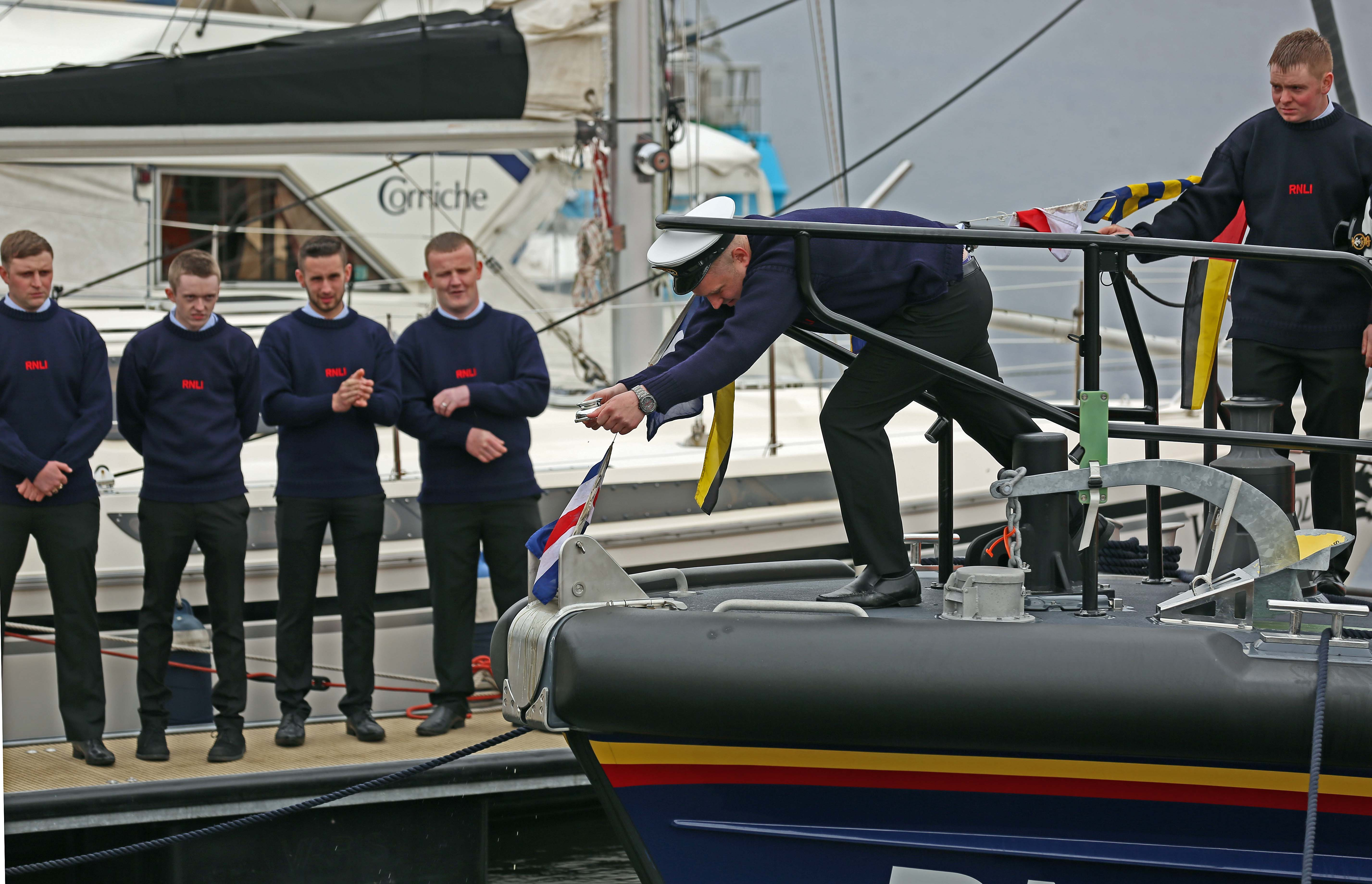 Coxwain/Mechanic Callum Govus christens new lifeboat as Alan Reid names her from podium with the now traditional Quaic of Whisky