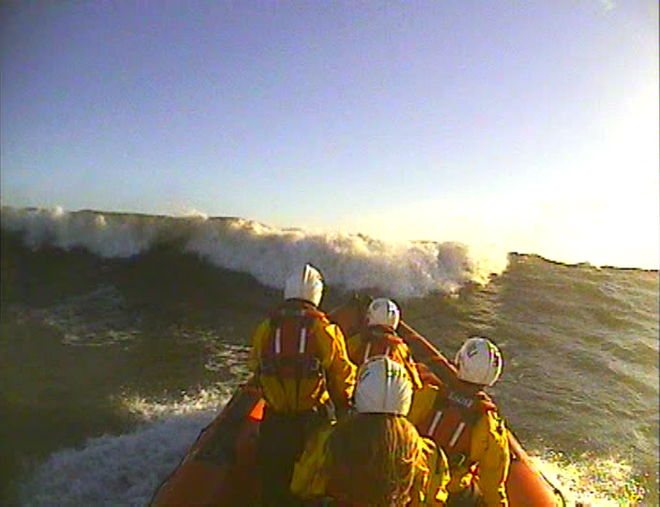 Cullercoats RNLI B class Atlantic 85 lifeboat approaches a large breaking wave during the search.