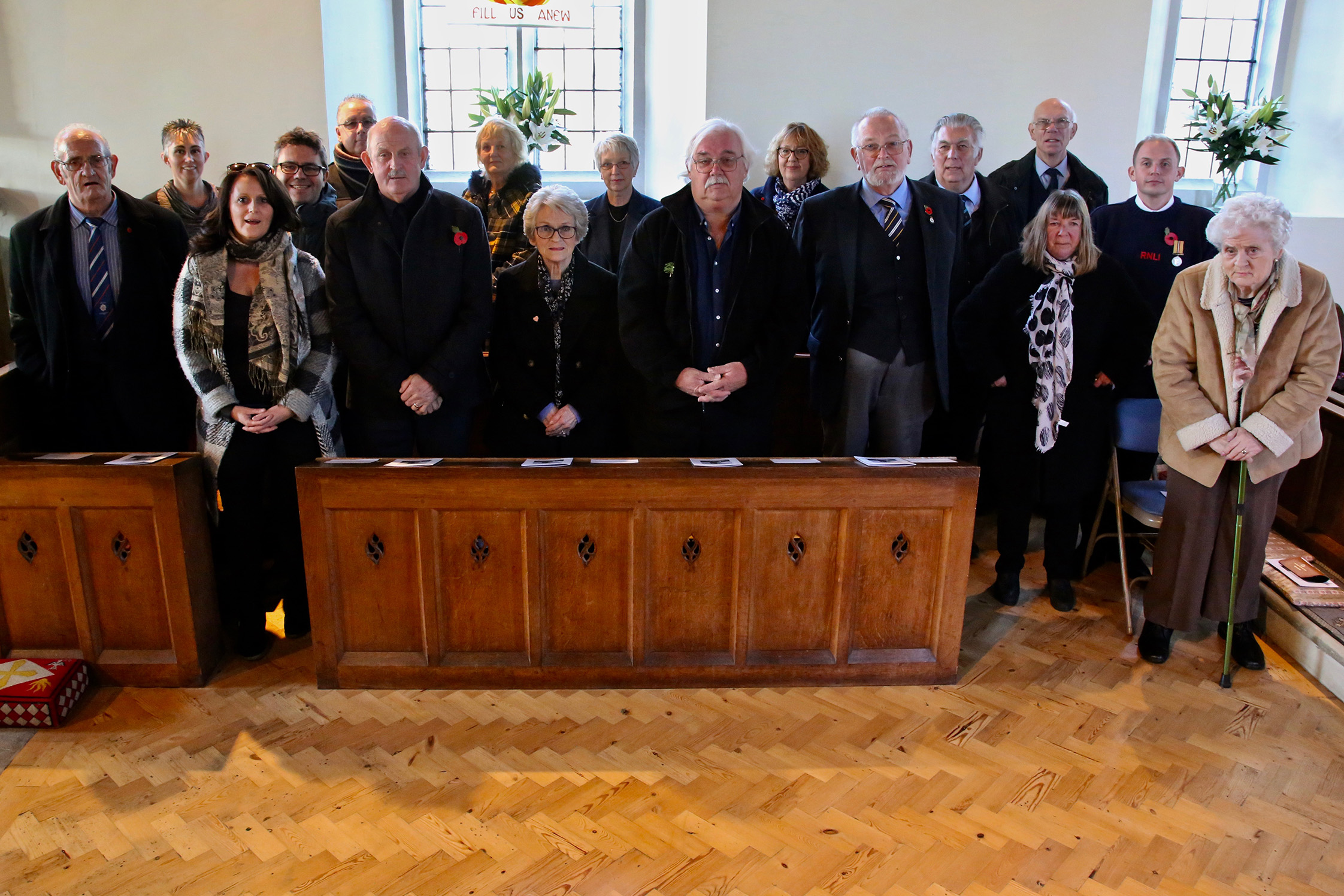 A gathering of seventeen descendants of the men who died in the Mary Stanford disaster standing in Rye Harbour church