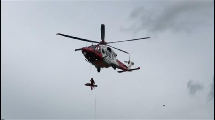 Logan being winched into the Coastguard helicopter
