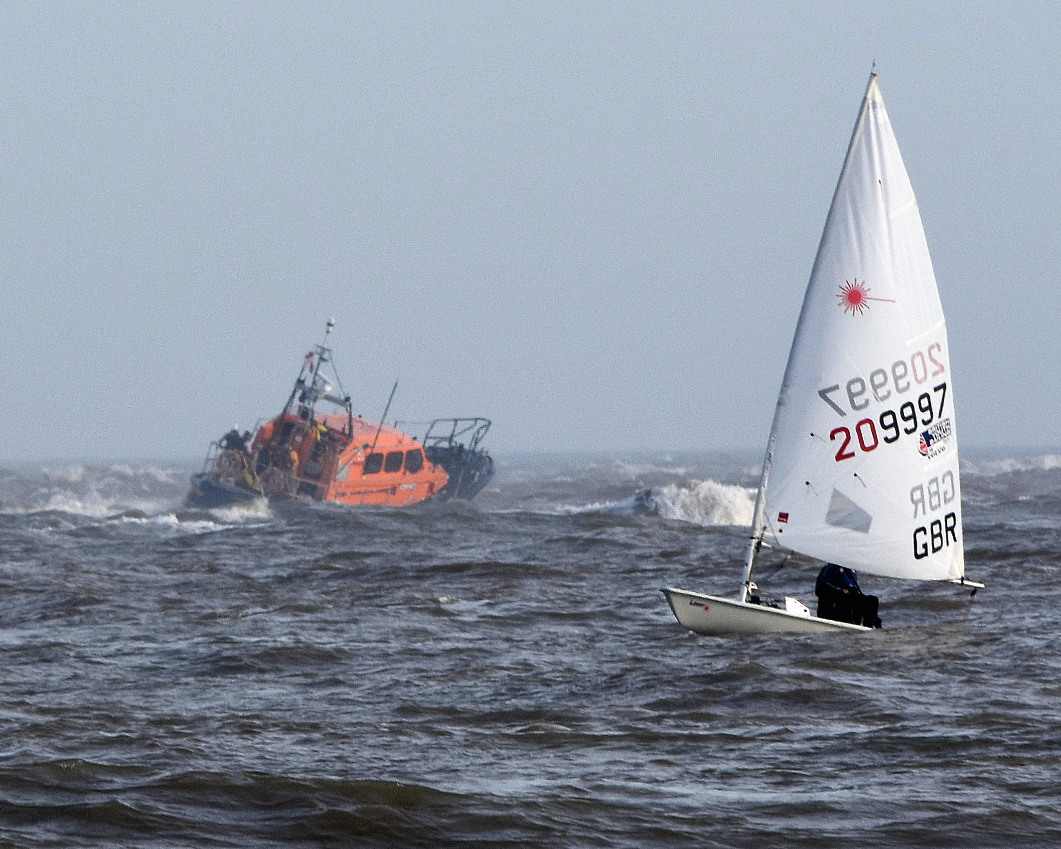 Lowestoft RNLI Lifeboat crosses the sandbank to reach the stranded safety boat