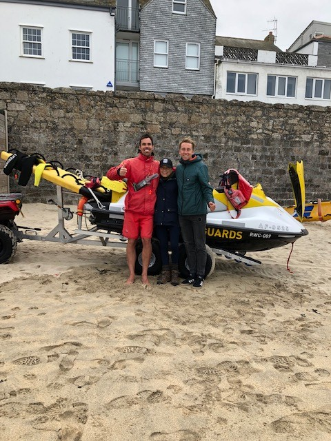 RNLI lifeguards James Symons (L) and Adam Bayfield (R) reunited with Virginia at Porthmeor