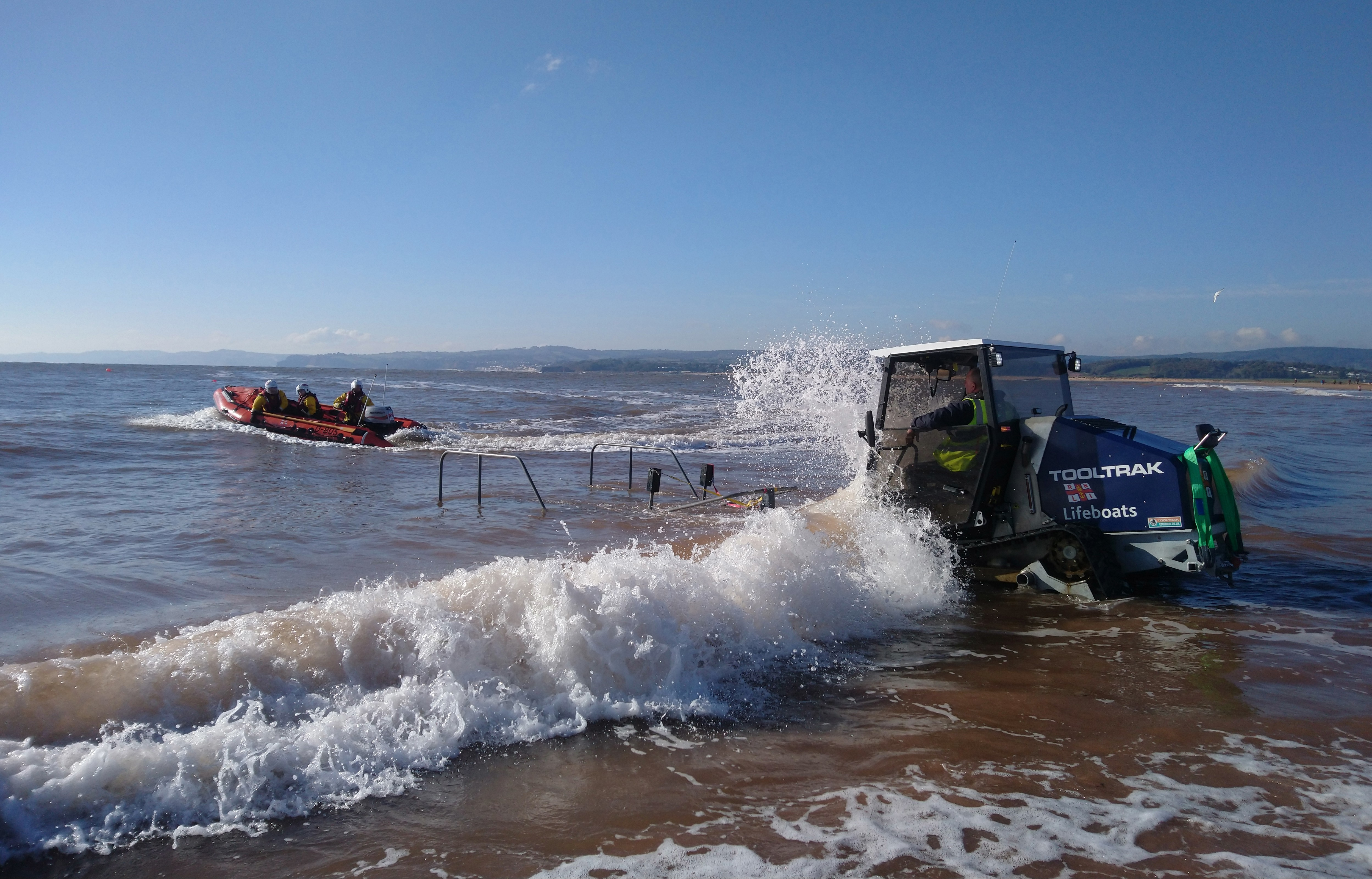 Inshore lifeboat George Bearman II recovers on the beach, after service