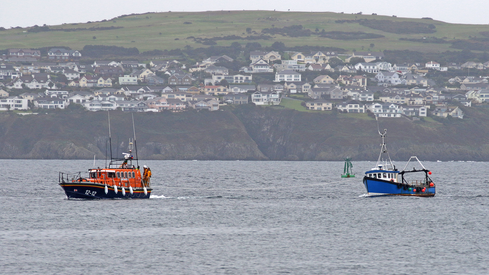 Douglas all-weather lifeboat Marine Engineer with casualty vessel entering Douglas harbour