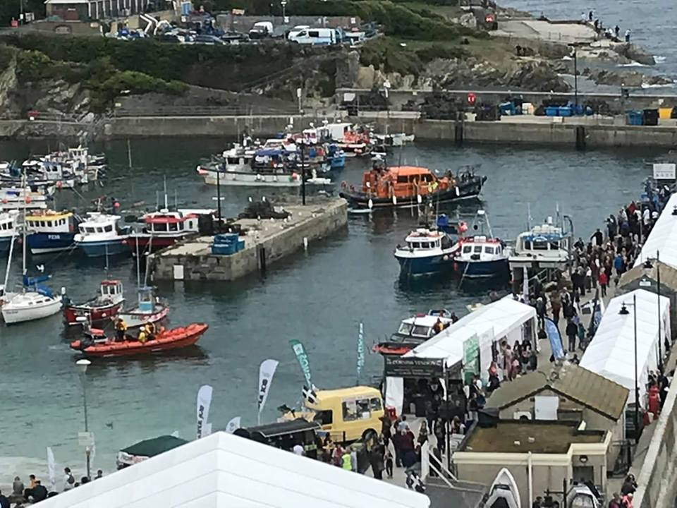 Newquay and St Ives lifeboats in Newquay Harbour after towing cabin cruiser to safety