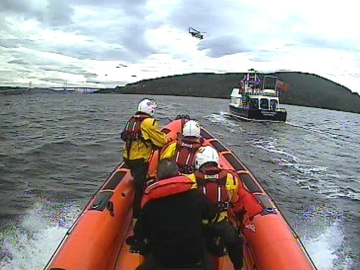 RNLI Kessock evacuate crew from casualty vessel to the Dolphin Spirit who stopped to help