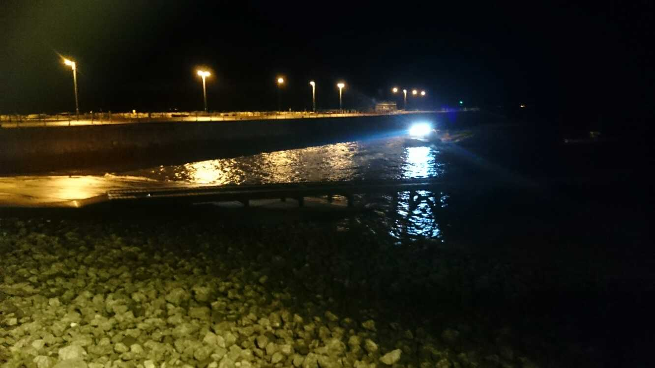 Inshore Rescue Hovercraft recovering at night.