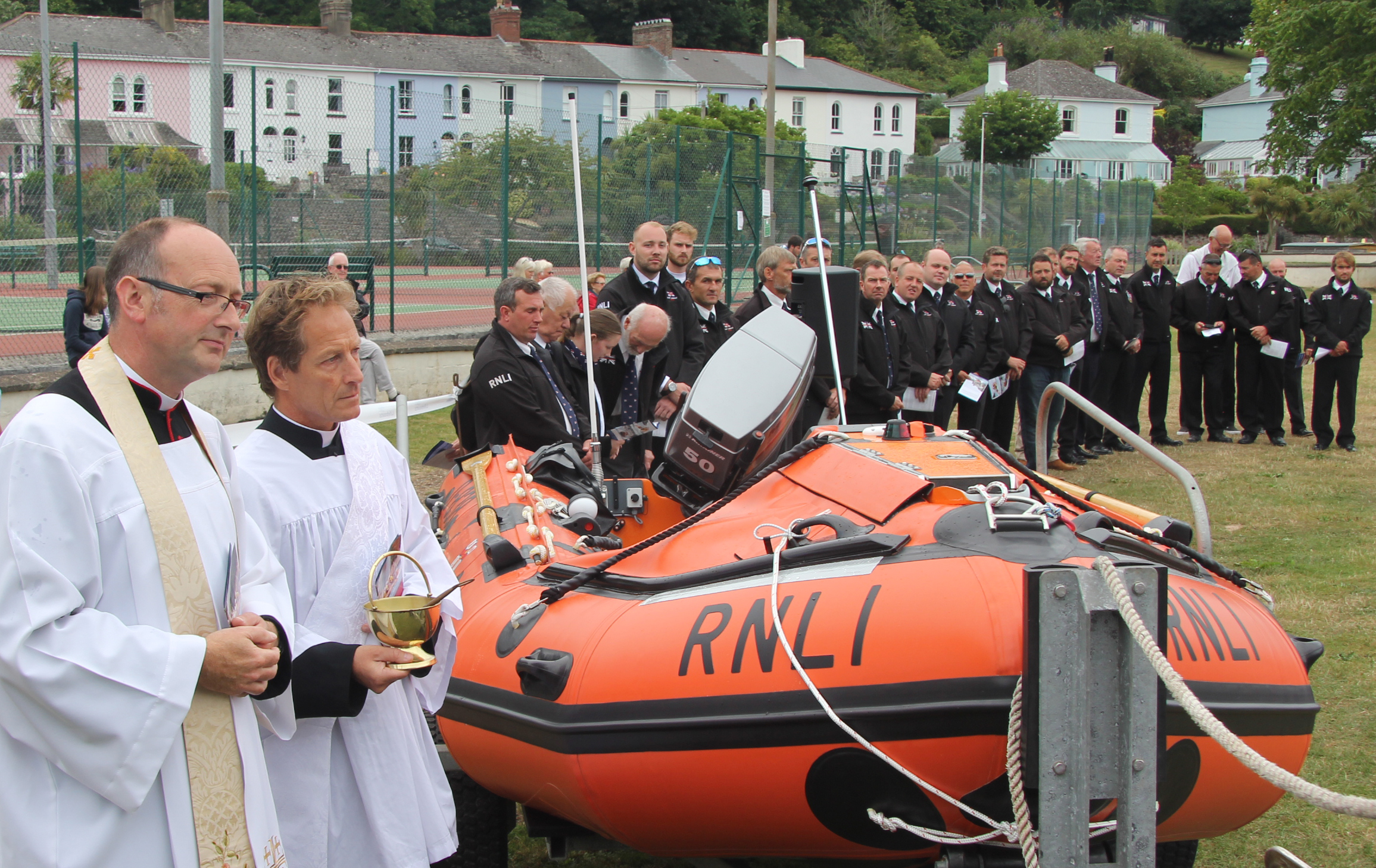 Fathers Will Hazelwood and Andrew Langley with the lifeboat volunteer crew at the blessing of the new lifeboat.