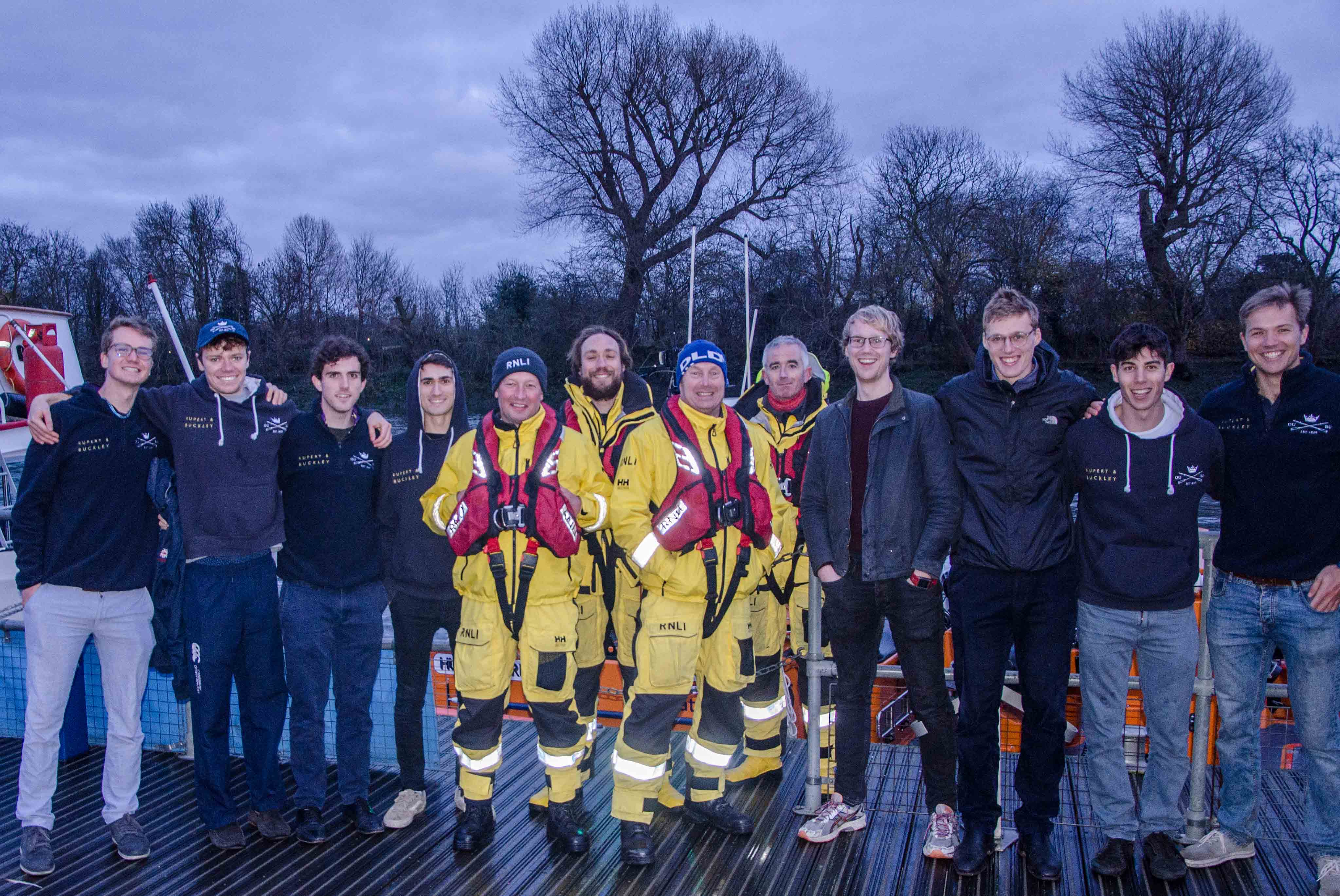 Oxford University mens Boat Race squad with Chiswick lifeboat crew