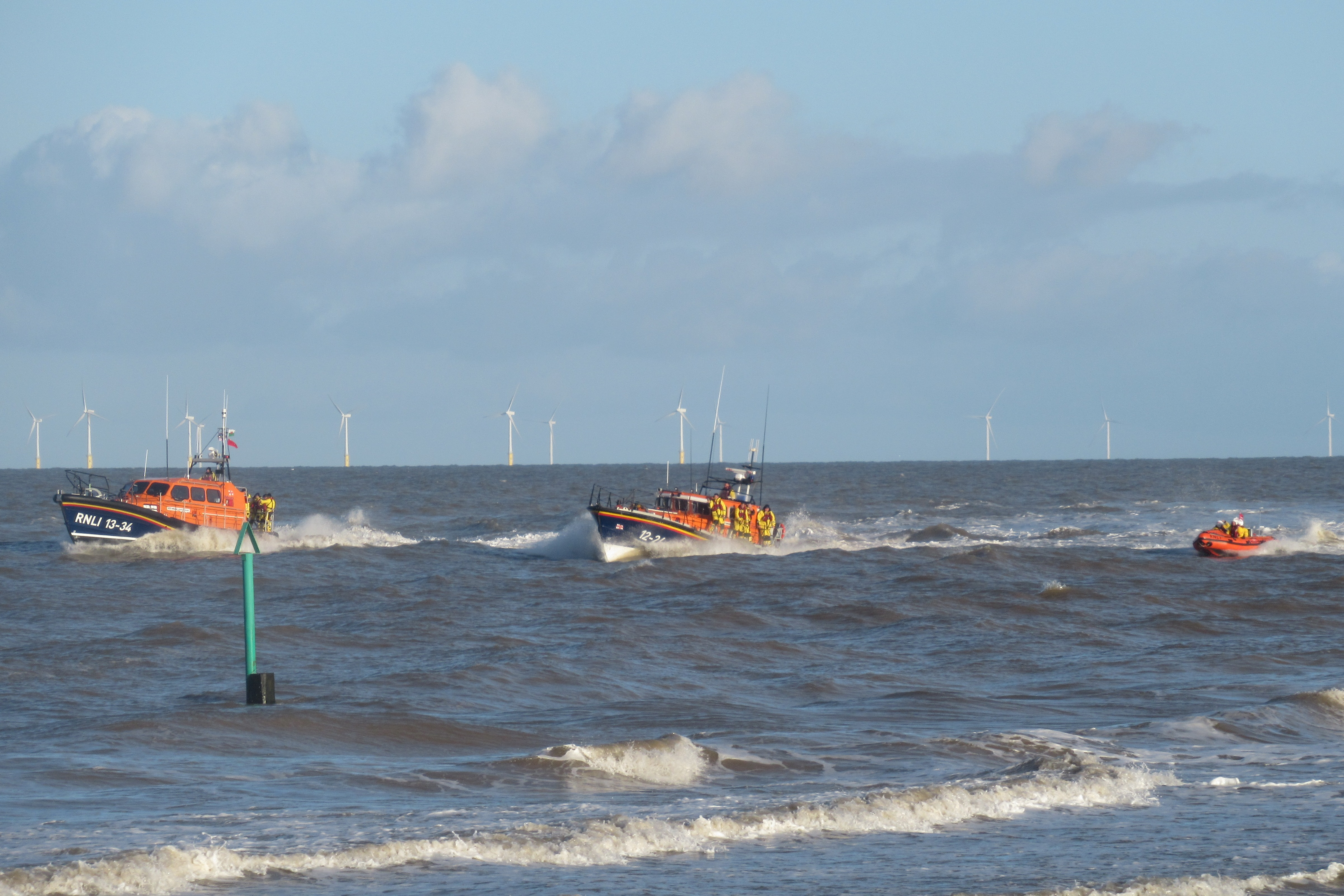 New Shannon, Mersey and ILB sail past station