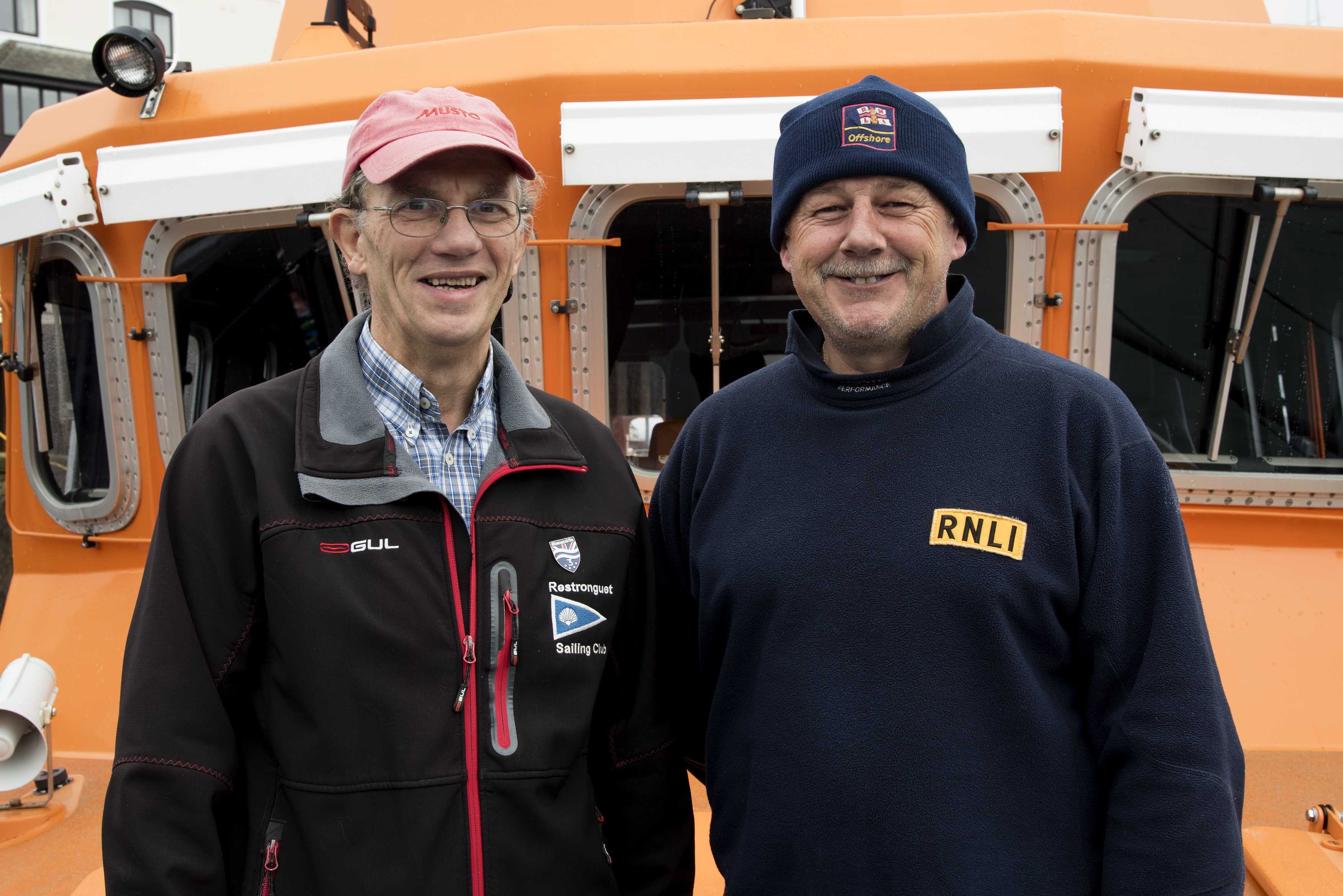 Henry Metcalfe, Restronguet Sailing Club Commodore with Falmouth RNLI Coxswain Jonathon Blakeston on board the station's Severn class all-weather lifeboat Richard Cox Scott