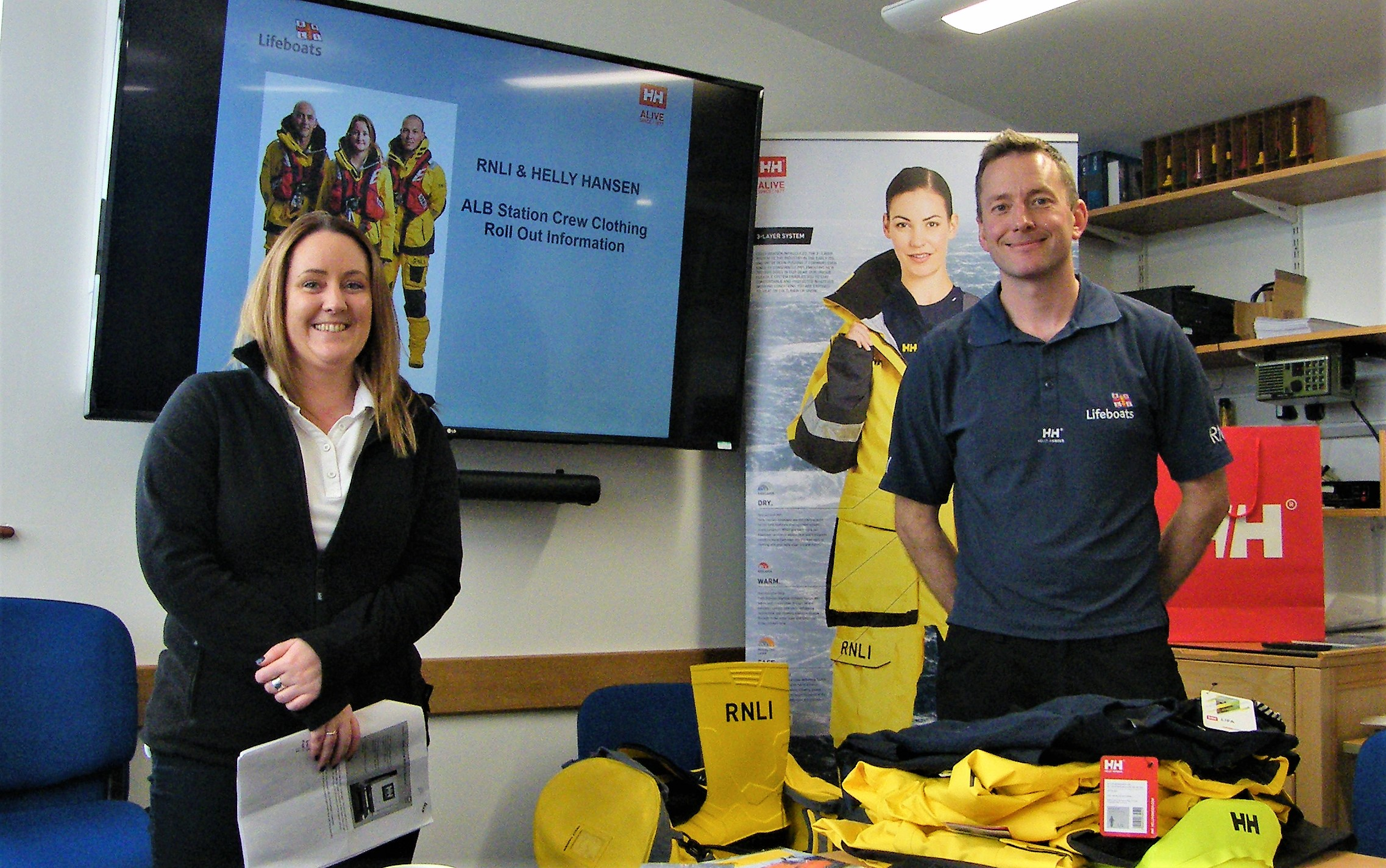 RNLI staff members Amanda Boon and Edward Elwood smiling to the camera with the new kit