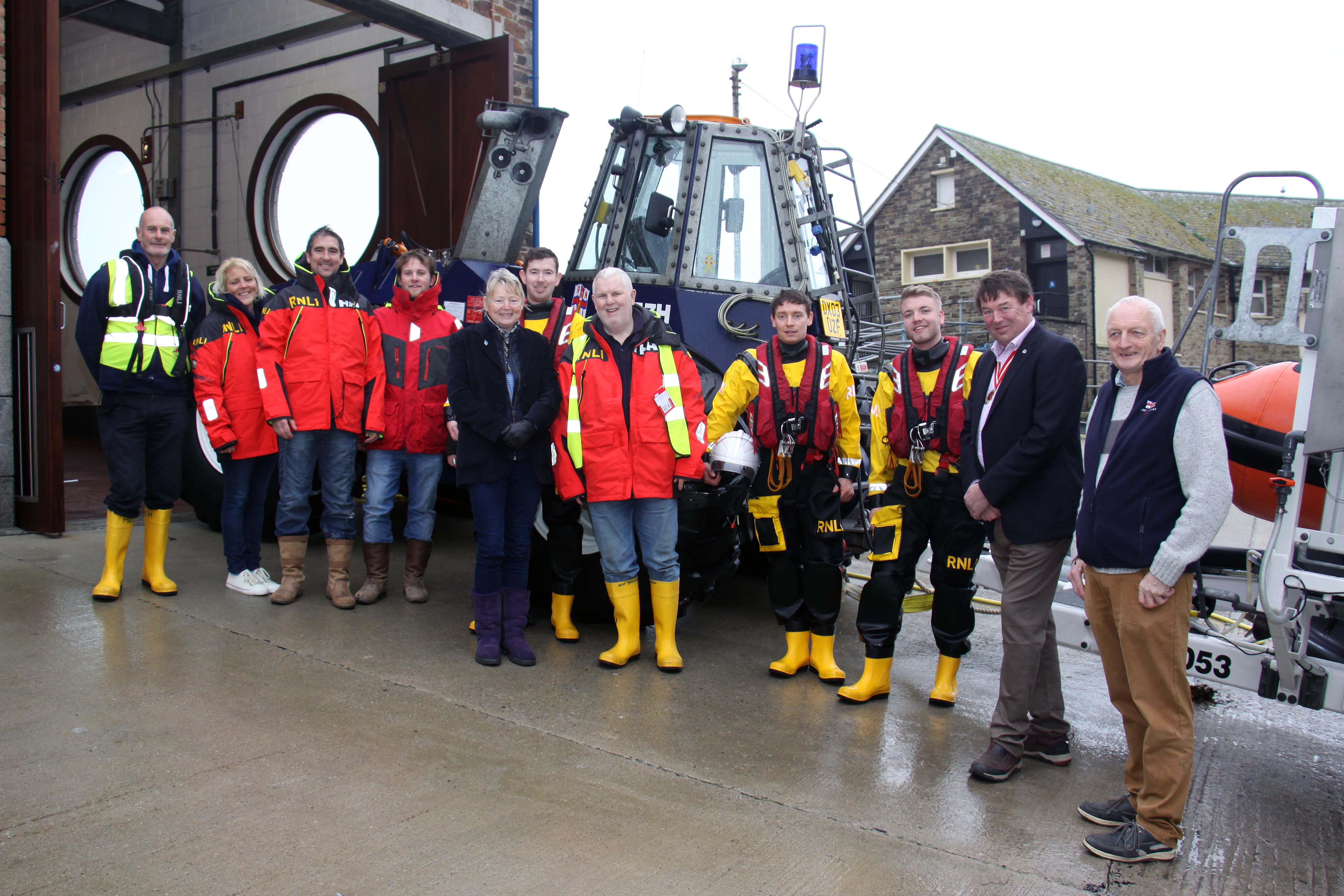 The High Sheriff of Cornwall Paul Young-Jamieson and Claire Young-Jamieson with Looe RNLI volunteer crew