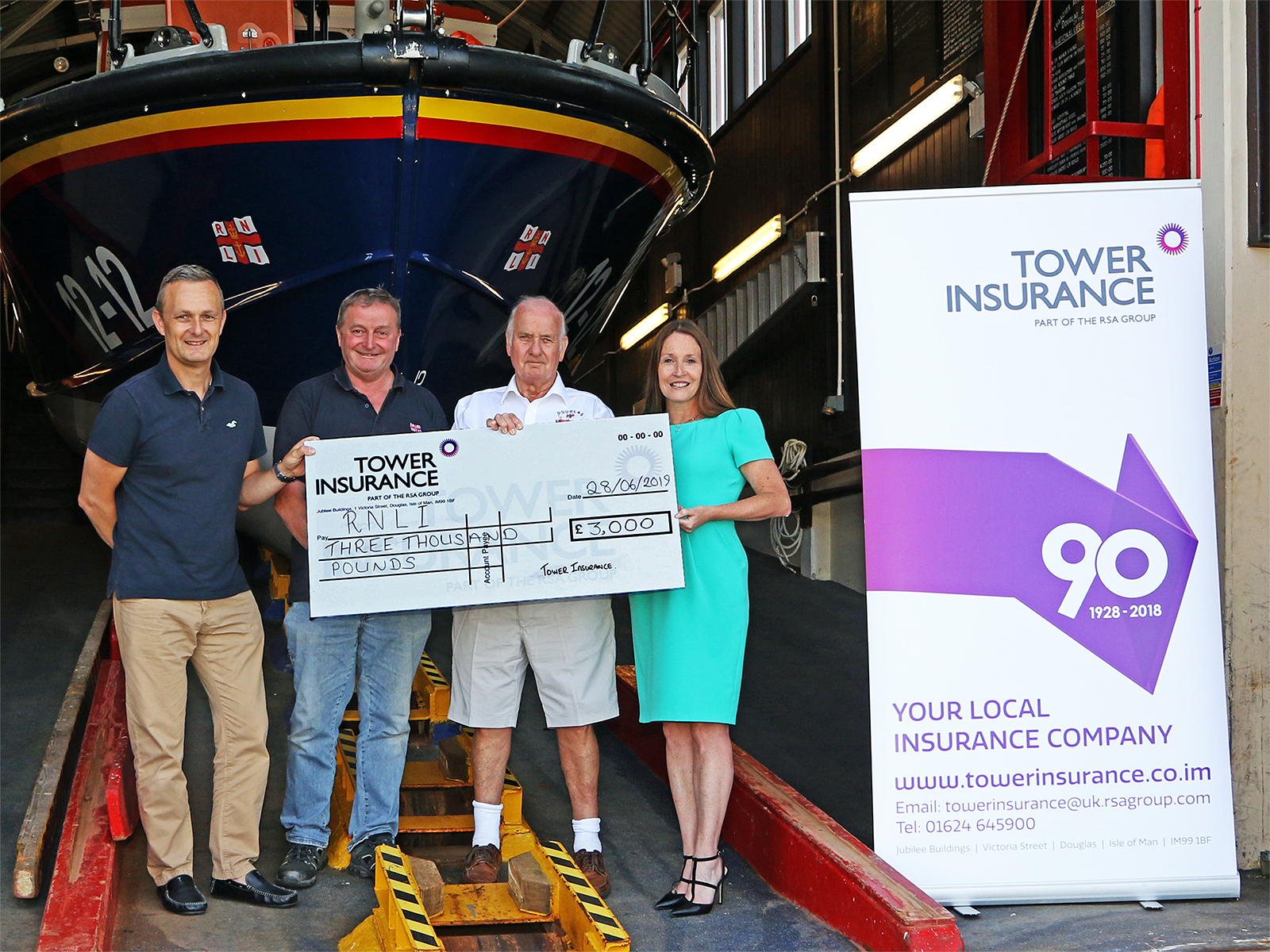 Cheque presentation L-R: Mr Richard Hulme (Tower Ins.), Mr Tony Radcliffe(RNLI), Mr Peter Cain(RNLI) and Ms Kellie Hands(Tower Ins.)
