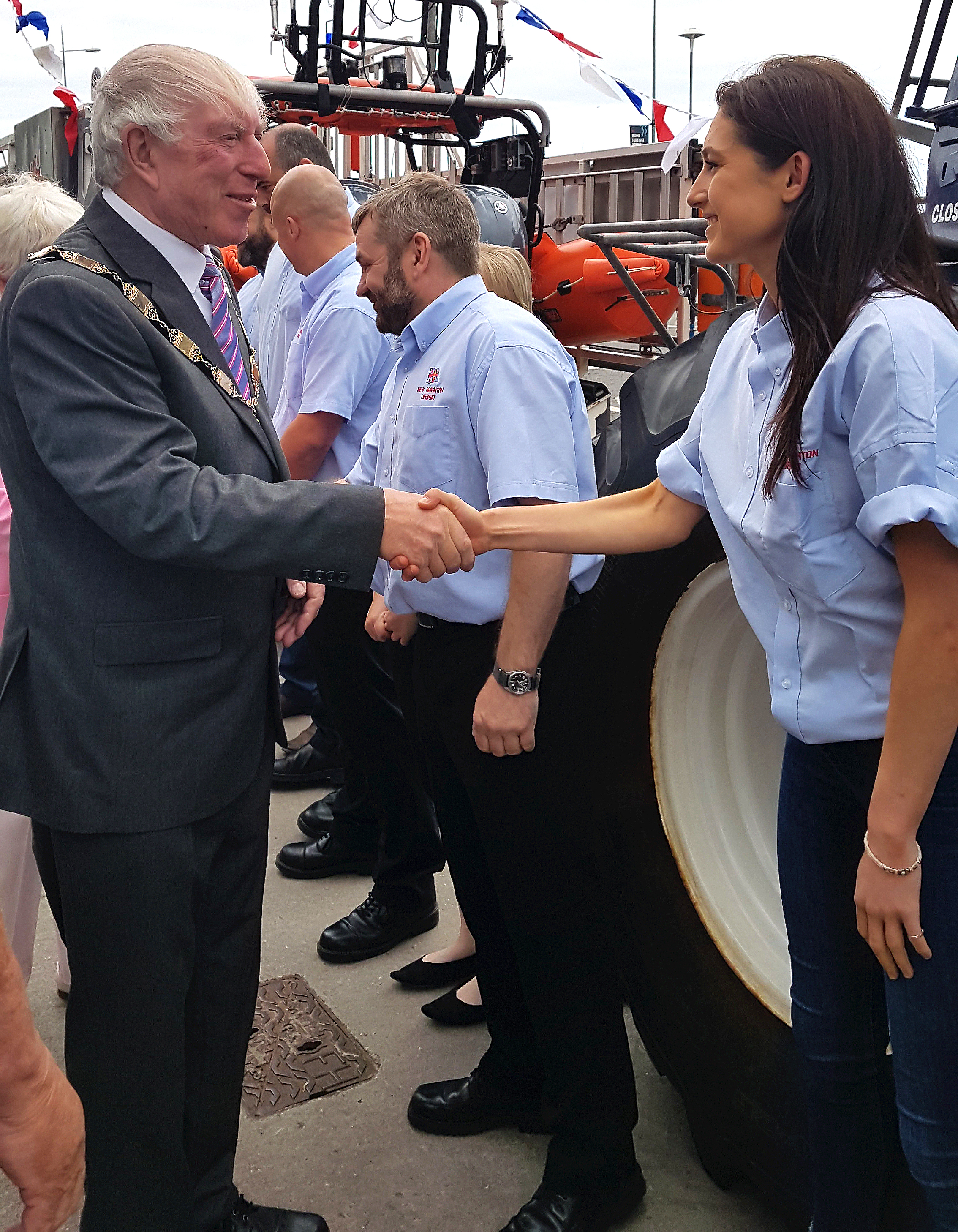 The deputy mayor shown shaking hands with Lucy as heads down the line of volunteer lifeboat crew
