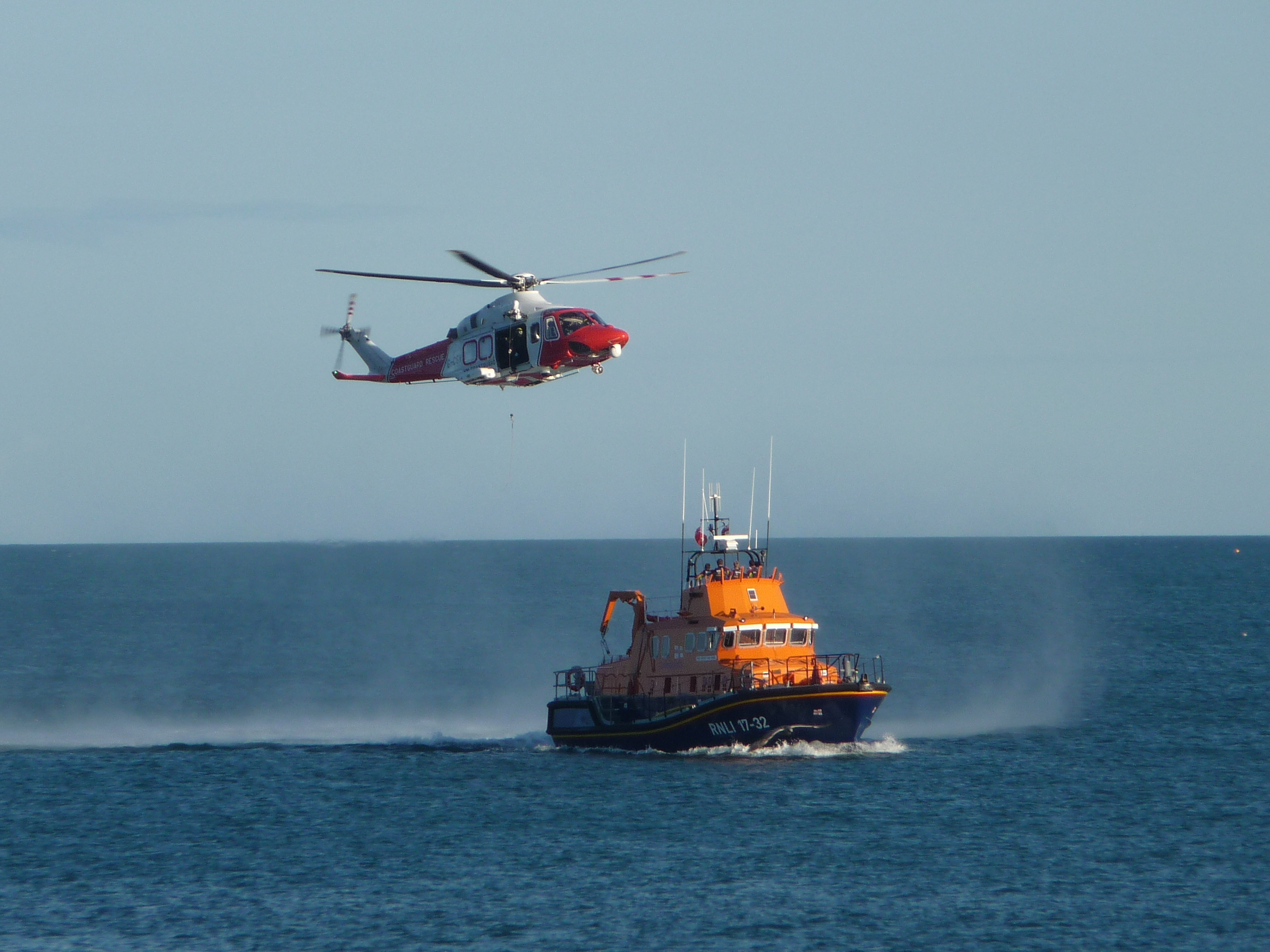Training exercise between Weymouth lifeboat and Coastguard helicopter