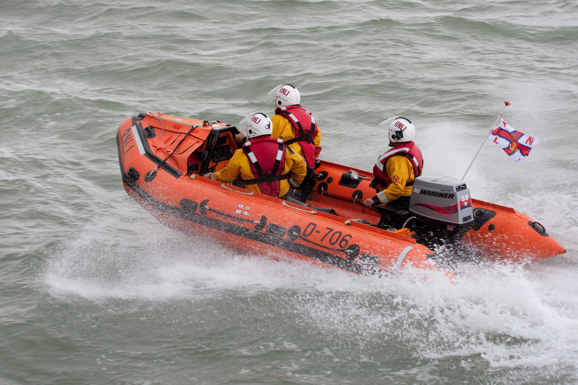 Photo of the Margate inshore lifeboat at sea with three crew