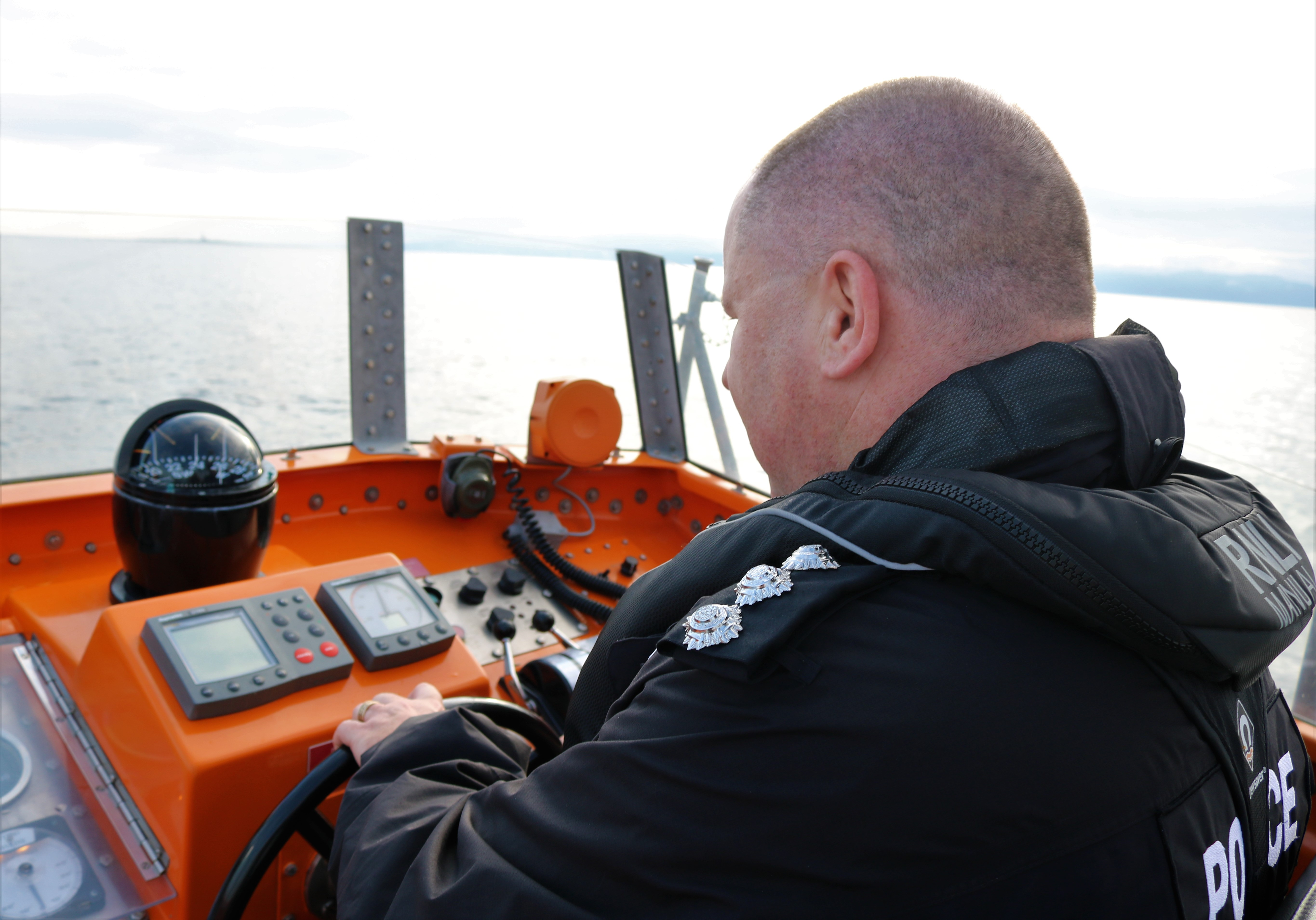Chief Inspector Brian Anderson takes the helm of RNLB Jim Moffat