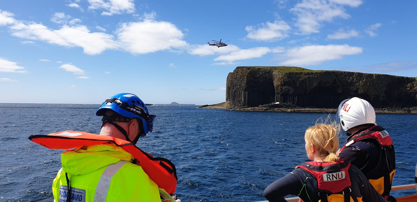Rescue 151 preparing to winch casualty from Staffa