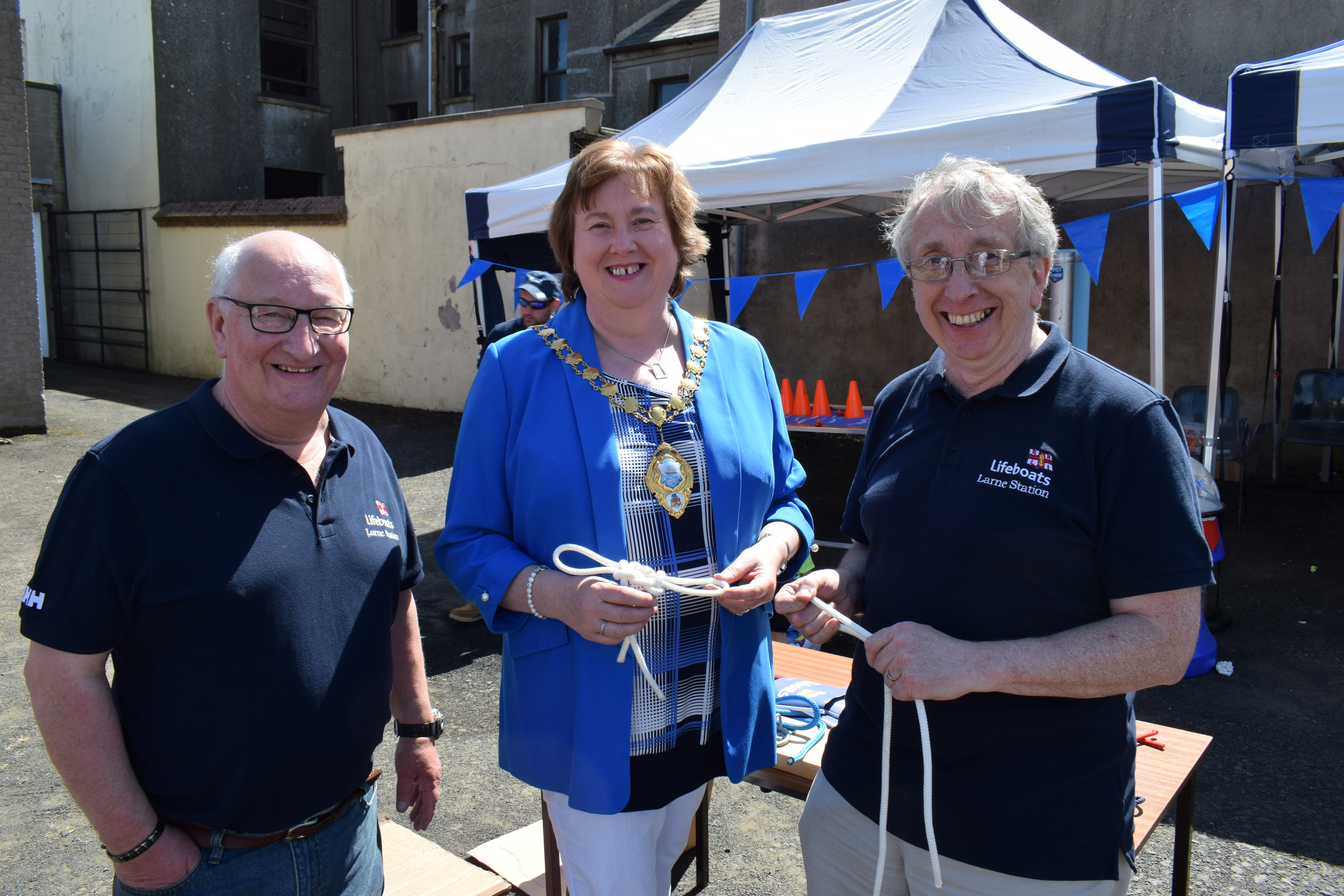Mayor of Mid and East Antrim Cllr. Maureen Morrow learning some knot tying with crew member Stephen Craig and Lifeboat Operations Manager Allan Dorman