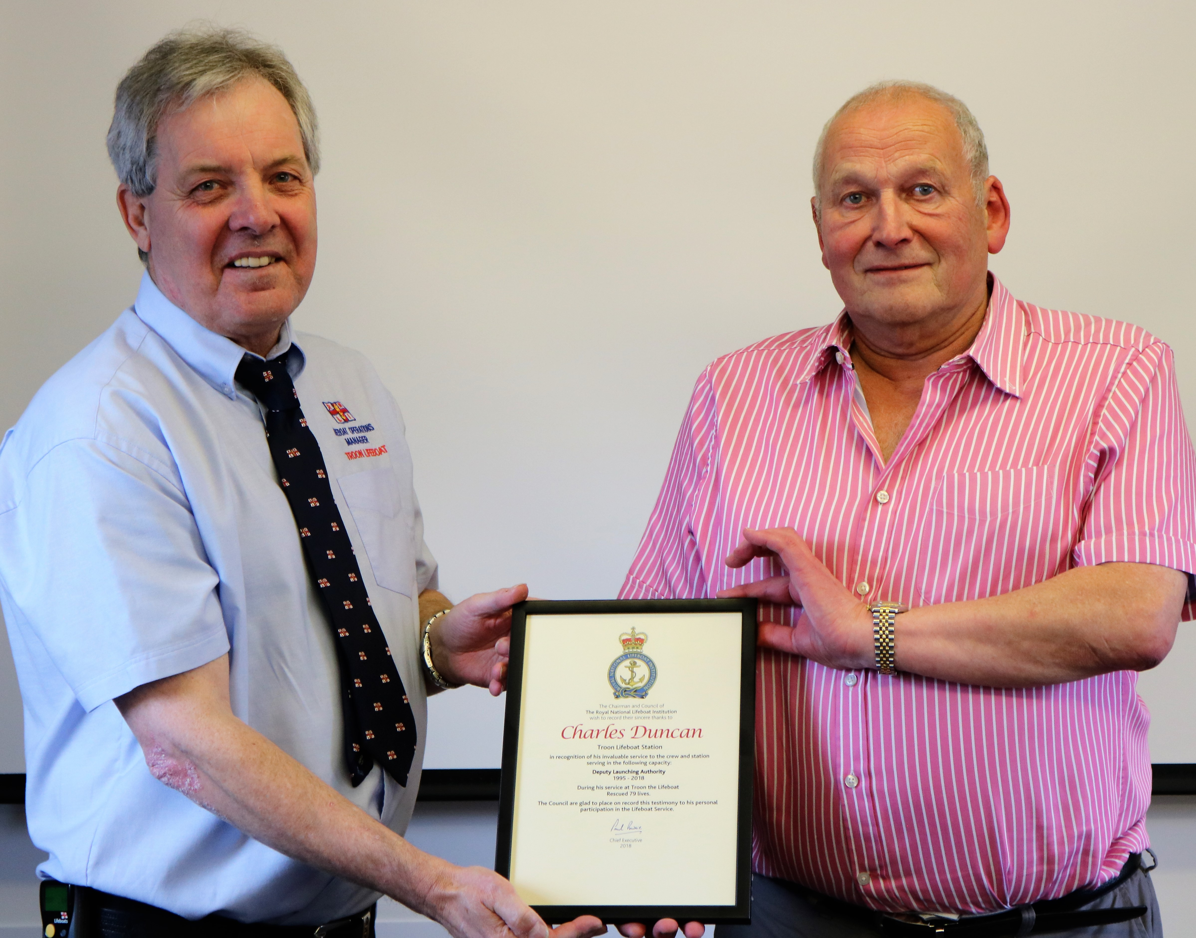 Pictured is Troon Lifeboat Operations Manager Jim Redmond (left) presenting the leaving certificate to Charlie Duncan