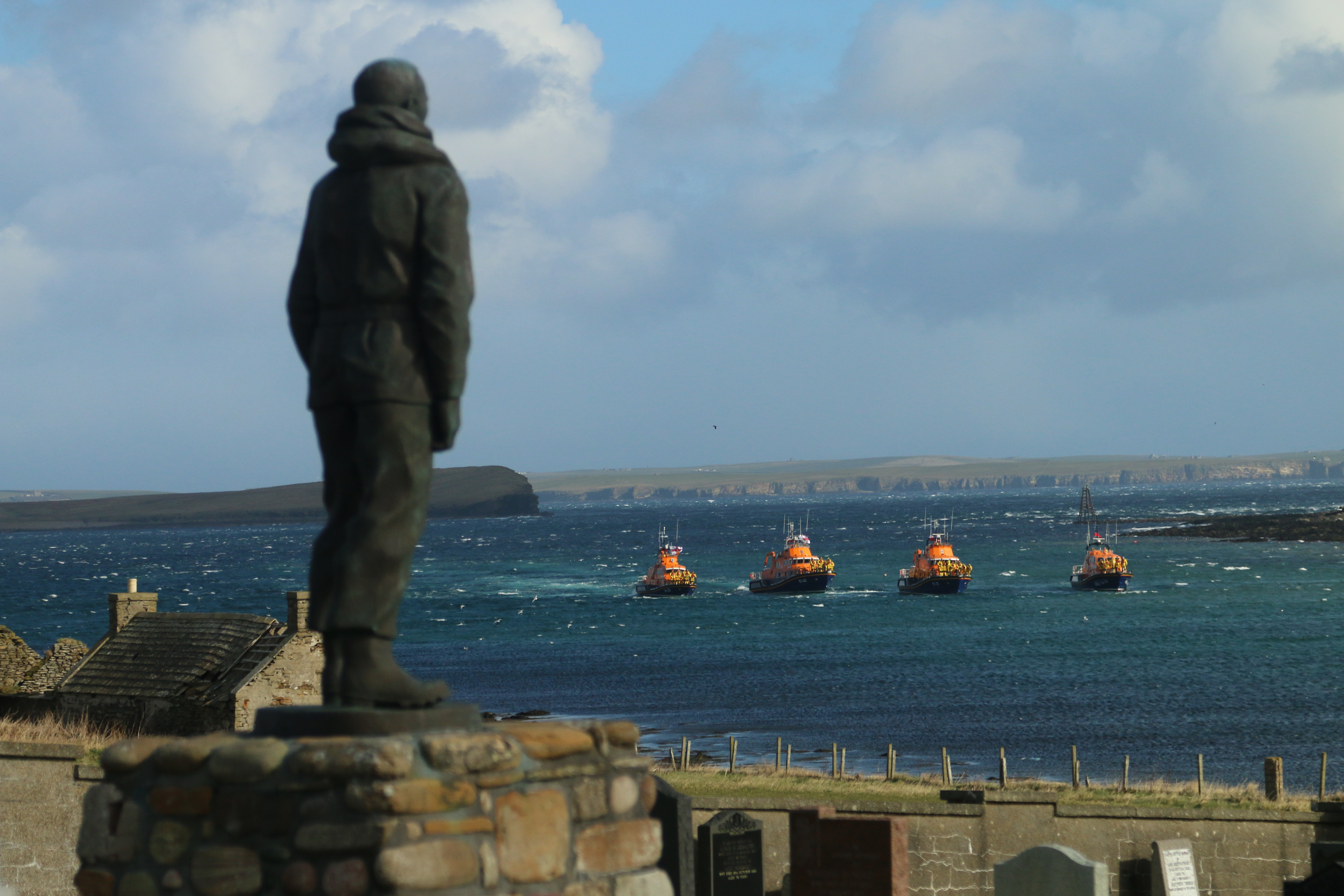 Lifeboats from Longhope, Stromness, Wick and Thurso pay their respects at the memorial to the lost crew of T.G.B