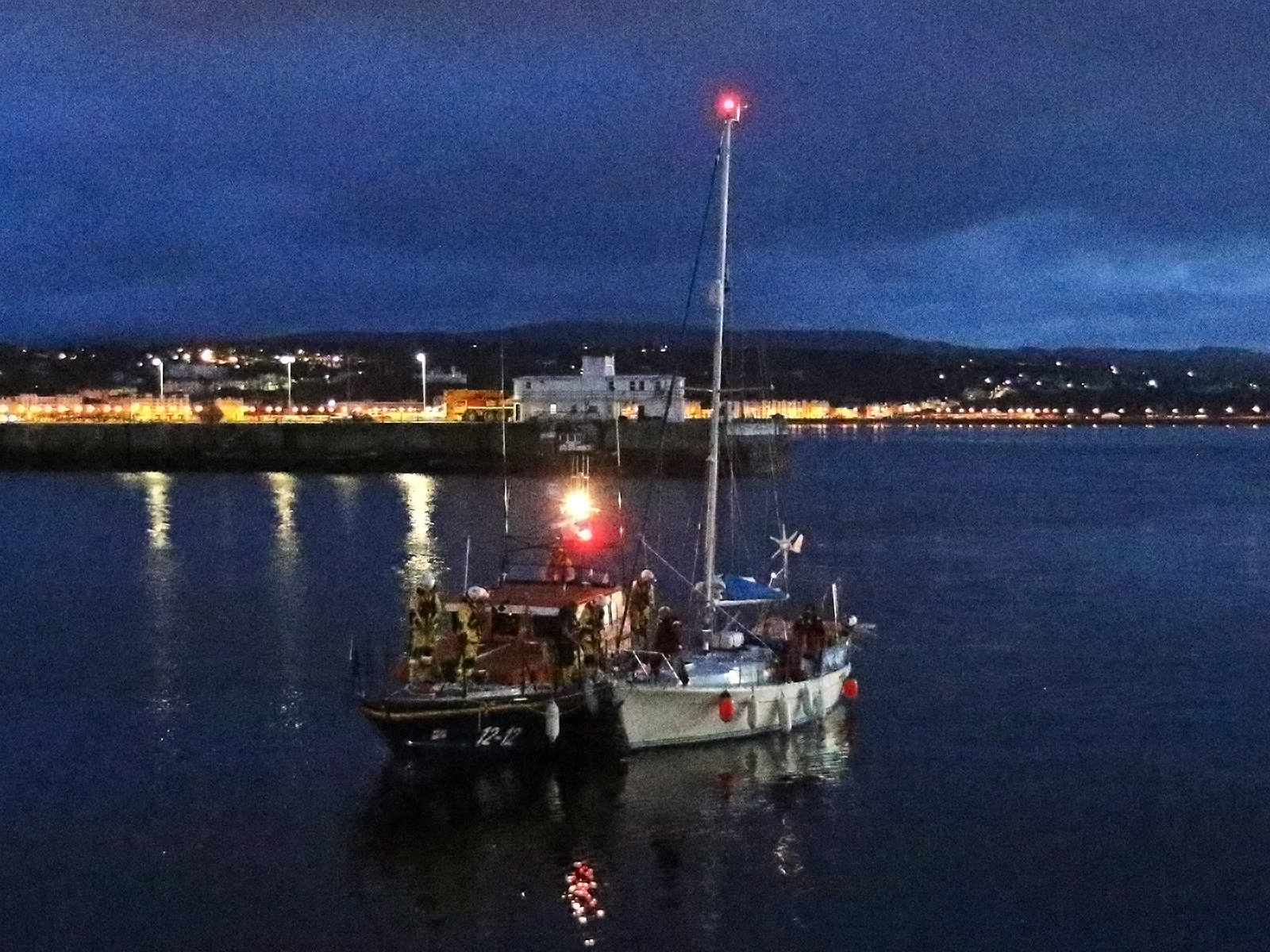 Douglas all-weather lifeboat Marine Engineer with casualty vessel returning to harbour