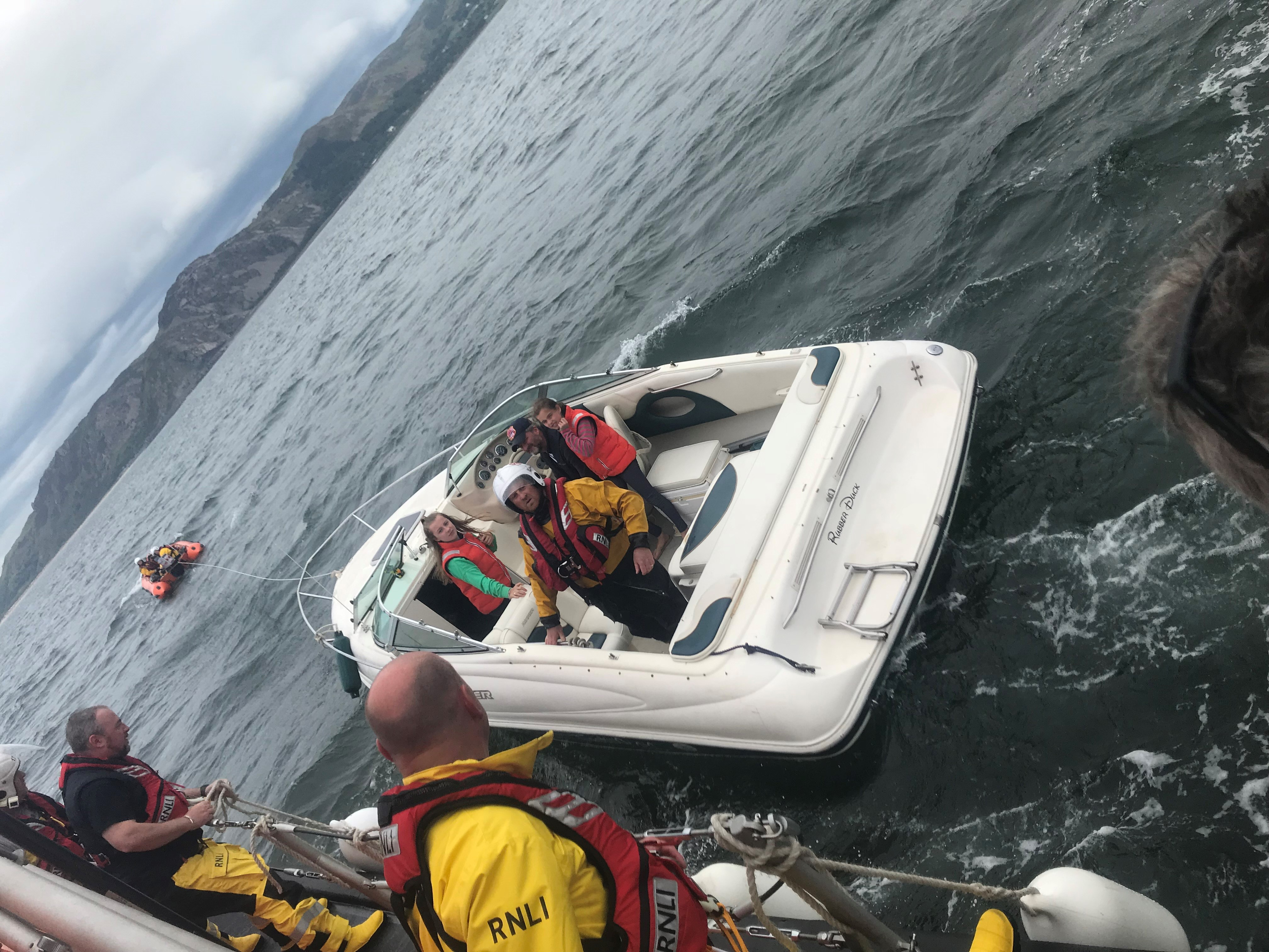 Conwy and Llandudno volunteer crews assist a family in their motorboat