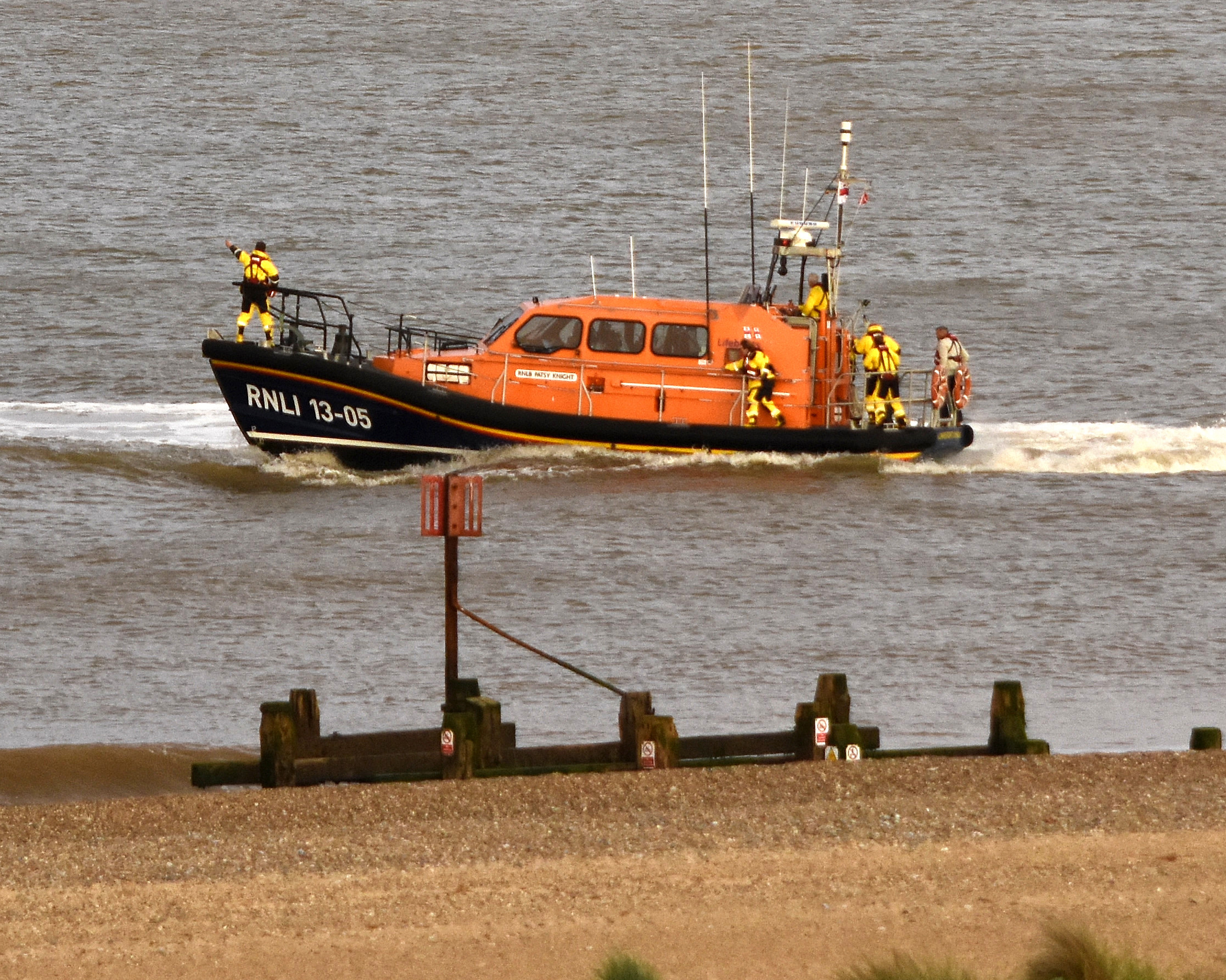 Lowestoft RNLI Lifeboat 'Patsy Knight' heads towards the person in the sea off Pakefield
