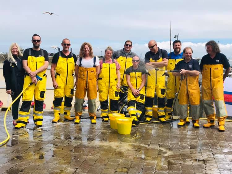 St Ives RNLI crew pictured in their yellow kit