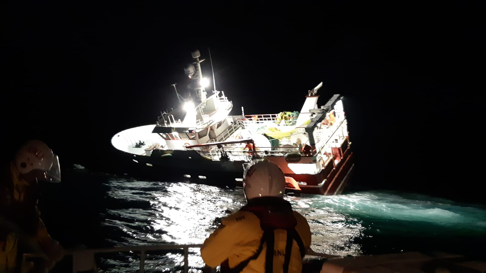 Lerwick lifeboat crew at the scene of the grounded vessel
