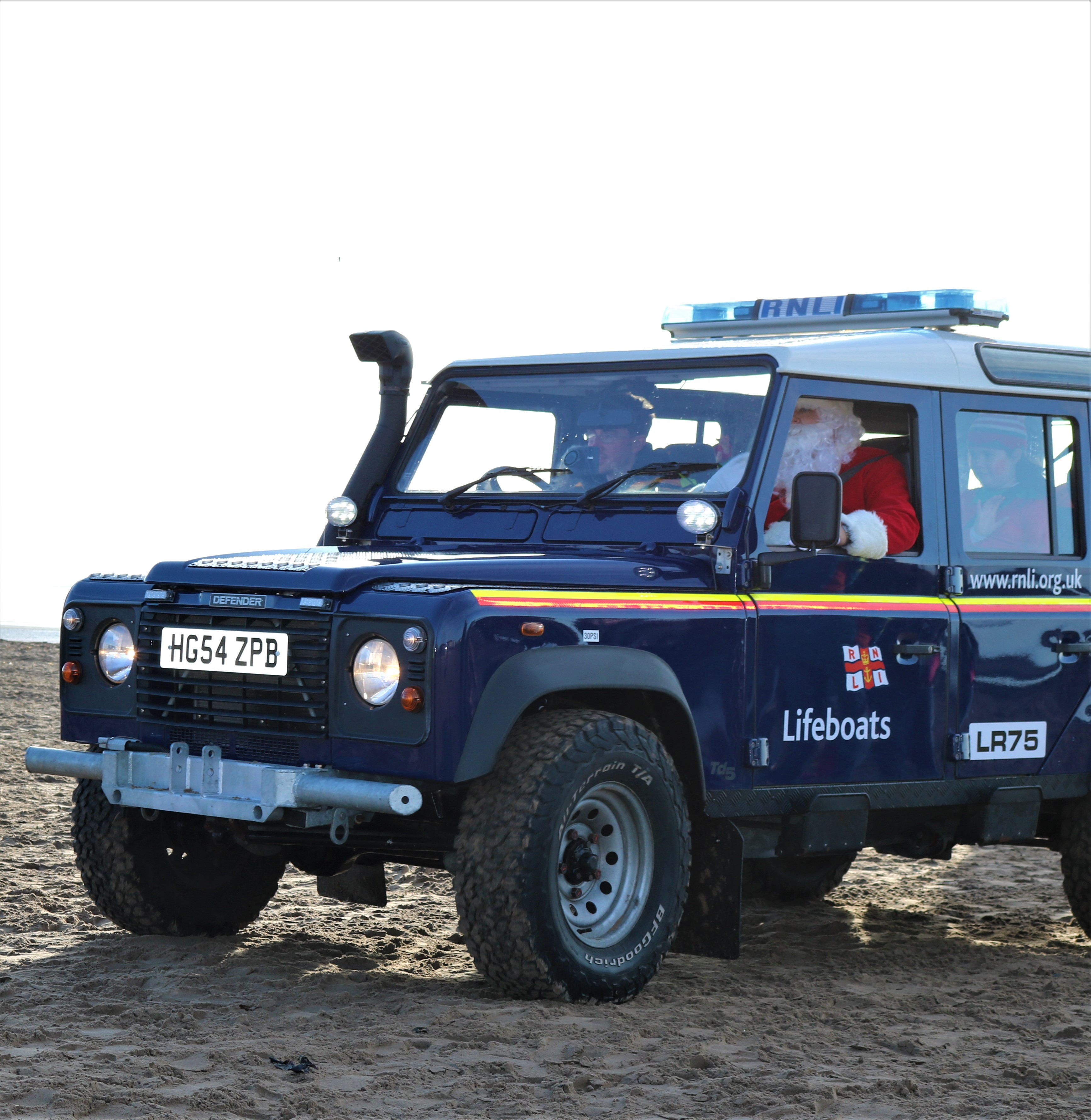Santa aboard the station RNLI Land Rover