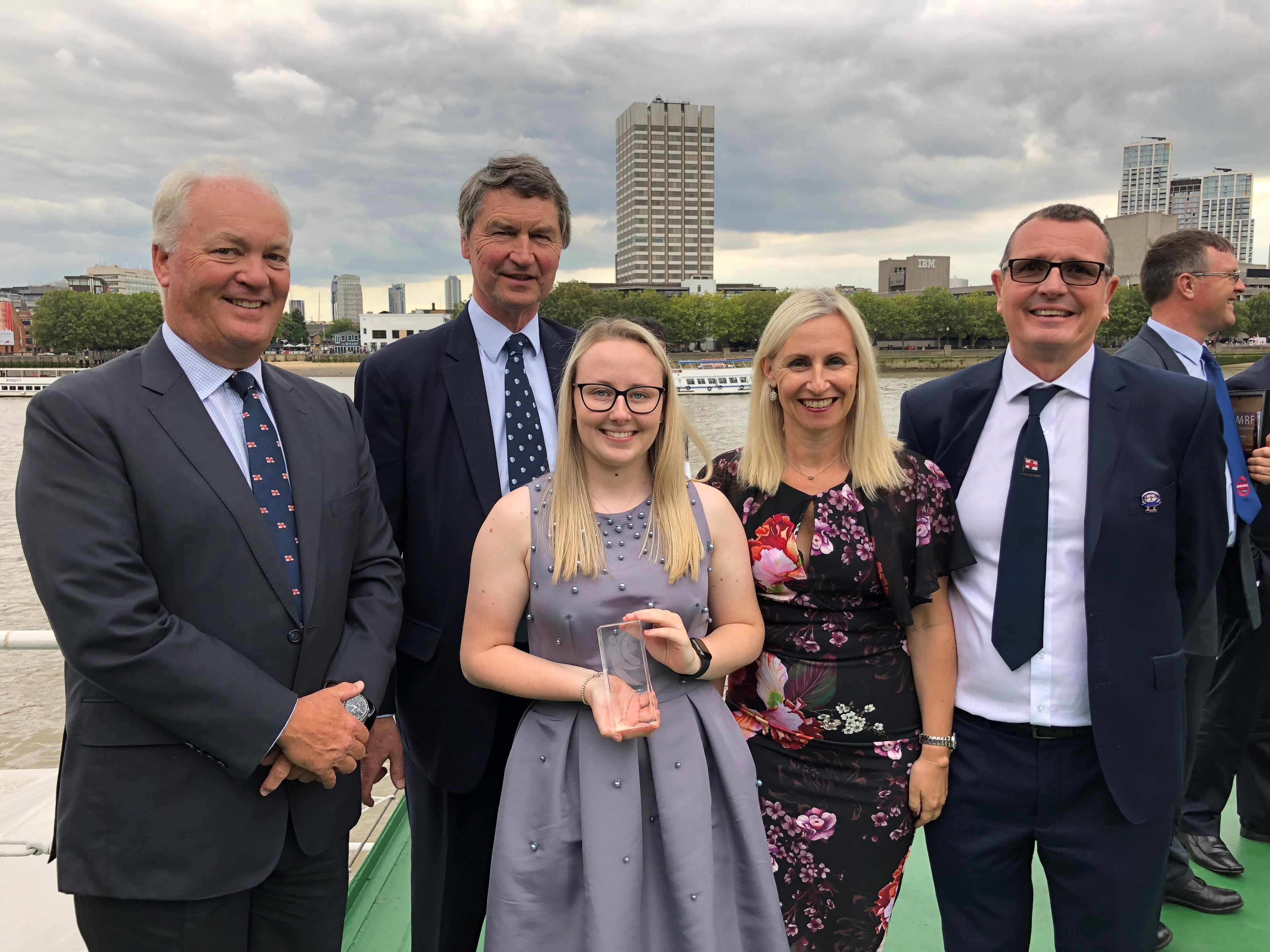 Isobel Tugwell pictured with her award. Also pictured are Mark Dowie (RNLI Chief Executive), Michelle Tugwell (Shoreham Press Officer) and Simon Tugwell (Second Coxswain and Mechanic at Shoreham)