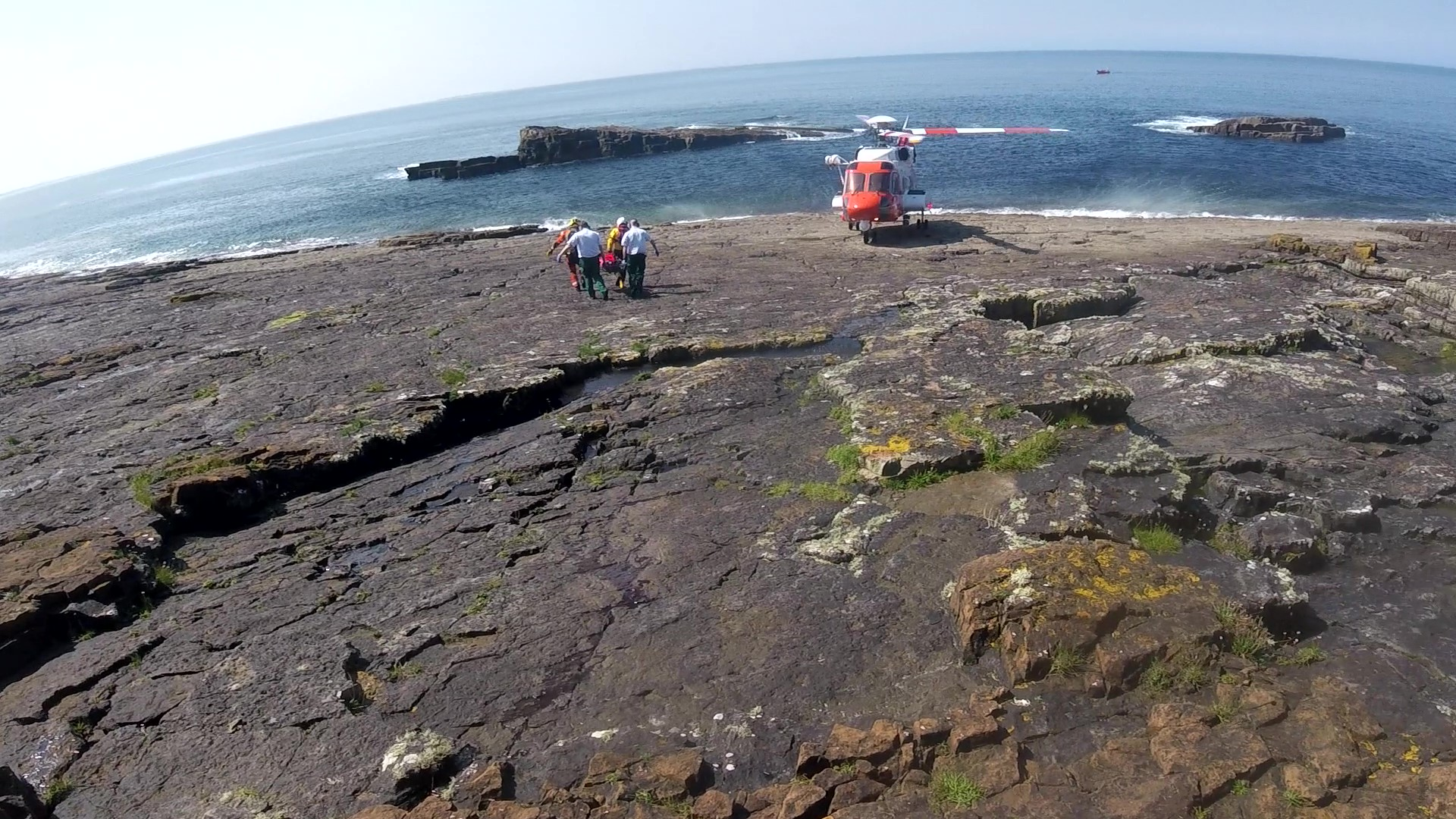 Photo shows casualty being carried by stretcher to the awaiting Rescue 118 helicopter